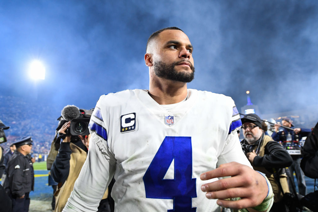 Quarterback Dak Prescott #4 of the Dallas Cowboys walks off the field at Los Angeles Memorial Coliseum on January 12, 2019 in Los Angeles, California.