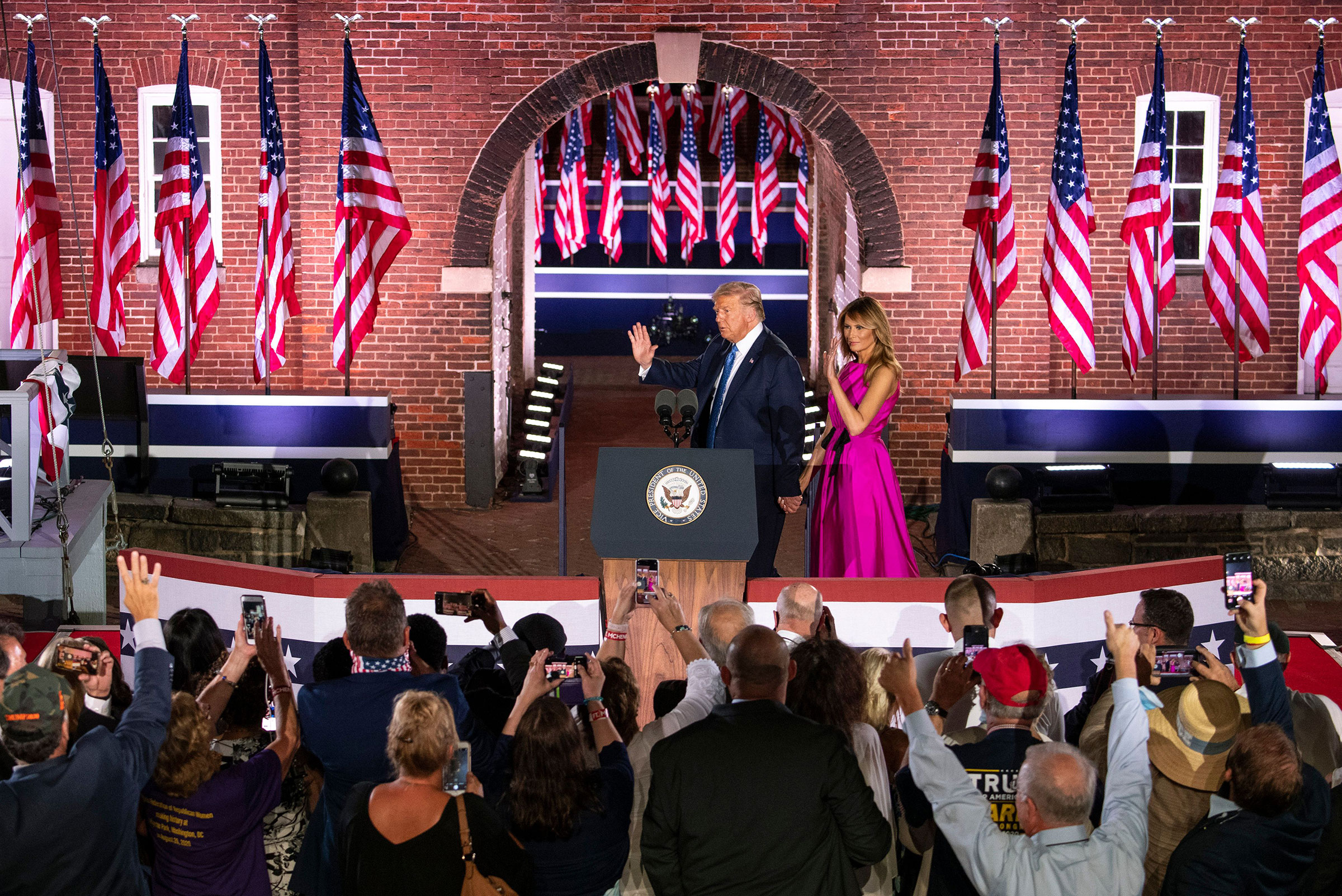 President Donald Trump and First Lady Melania Trump wave to supporters after attending the third night of the Republican National Convention, at Ft. McHenry in Baltimore, on Aug. 26, 2020.