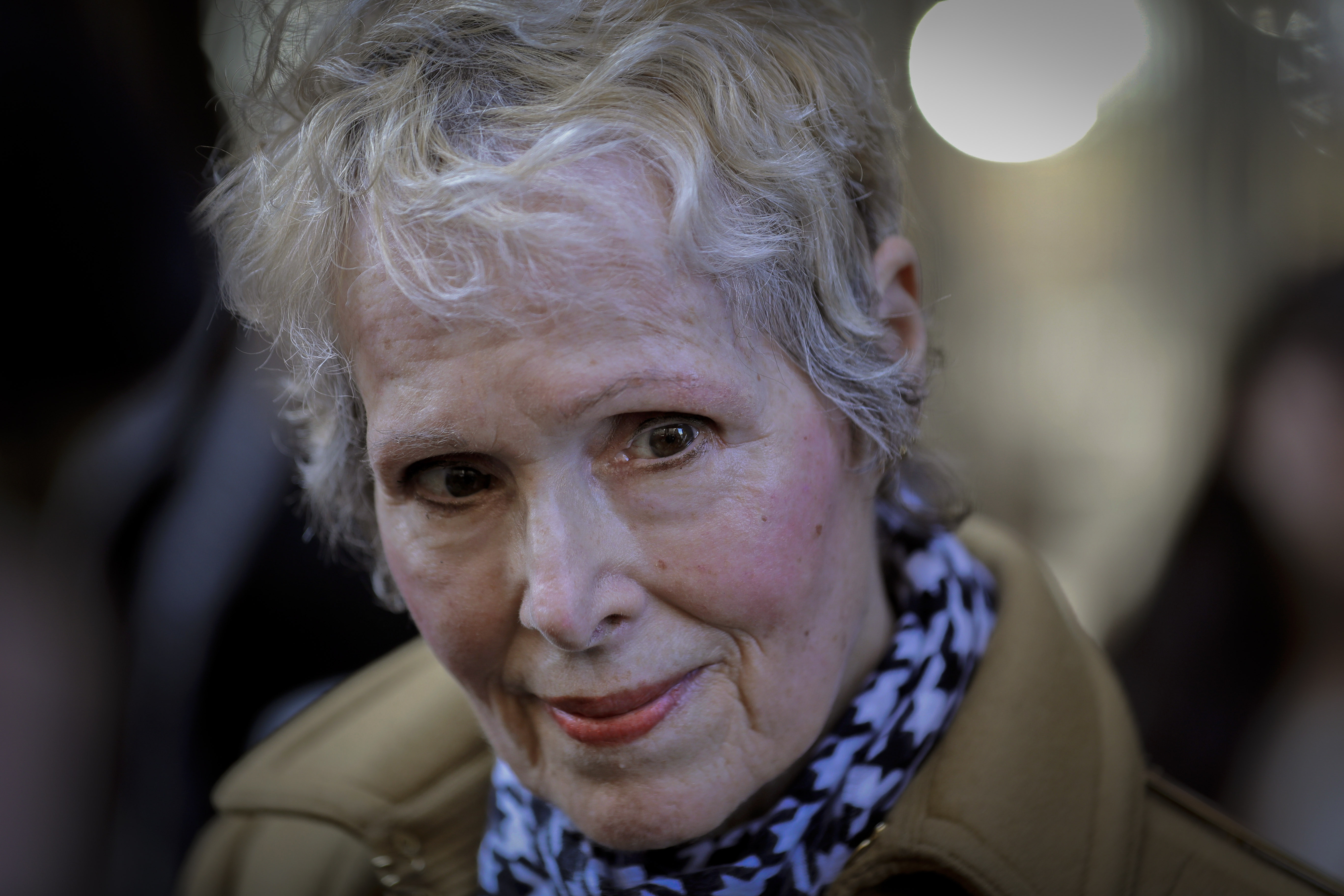 E. Jean Carroll talks to reporters outside a courthouse in New York on March 4, 2020.