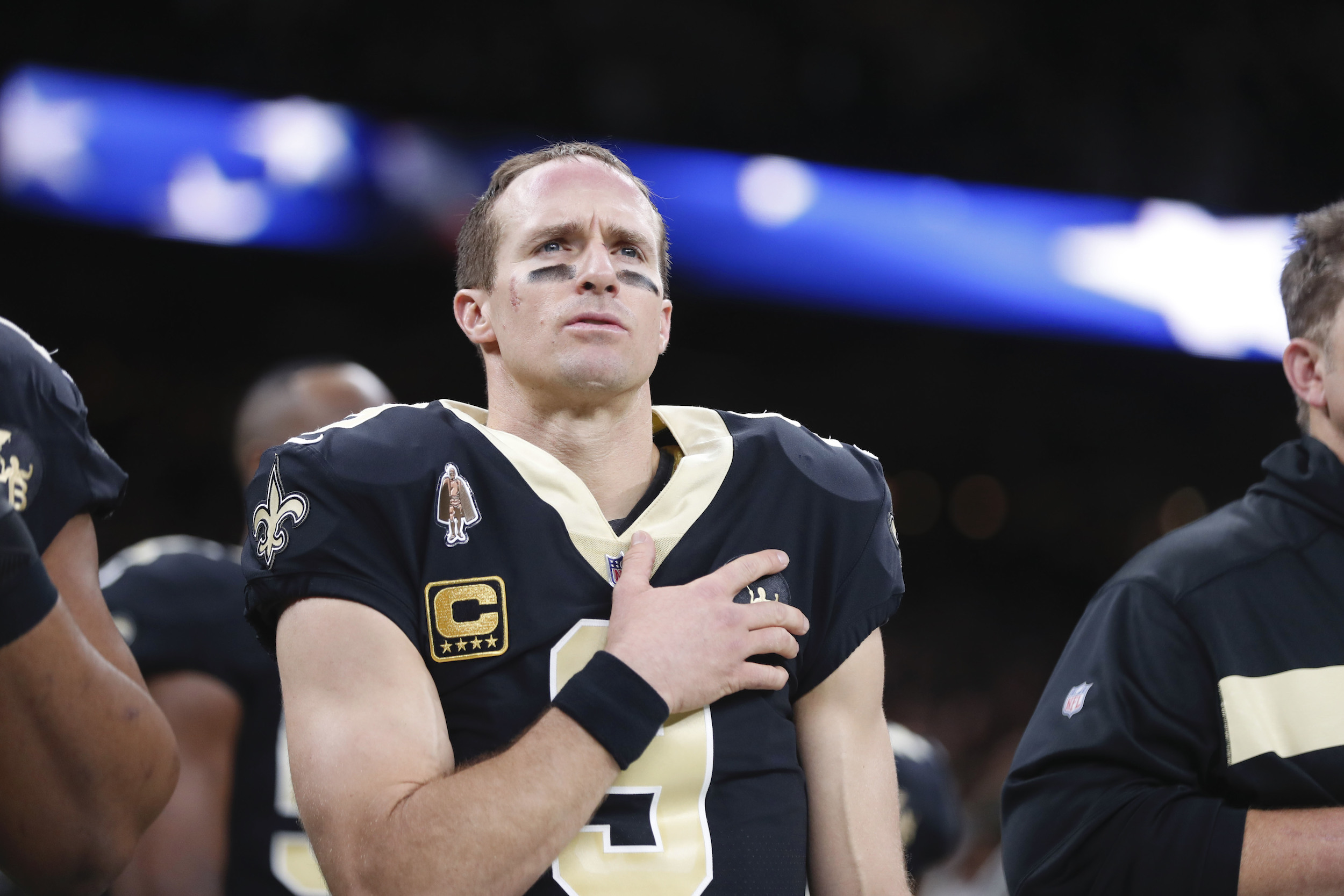 New Orleans Saints quarterback Drew Brees (9) holds his hand to his heart during the national anthem before an NFL football game against the Pittsburgh Steelers in New Orleans, on Dec. 23, 2018.
