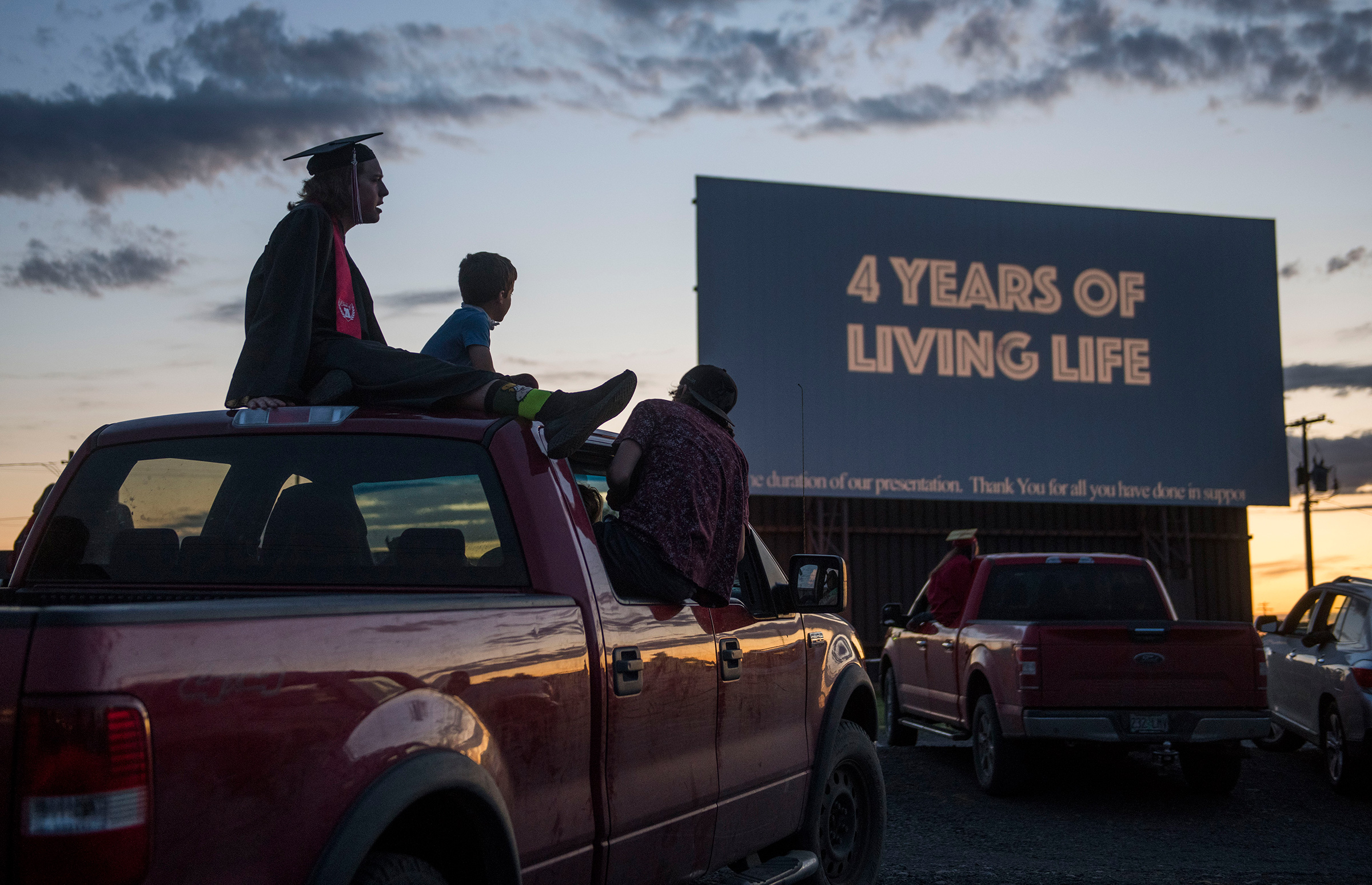 Cameron Curtindale, left, at a ceremony with Weston-McEwen High School classmates at the M-F Drive-In Theater in northern Oregon