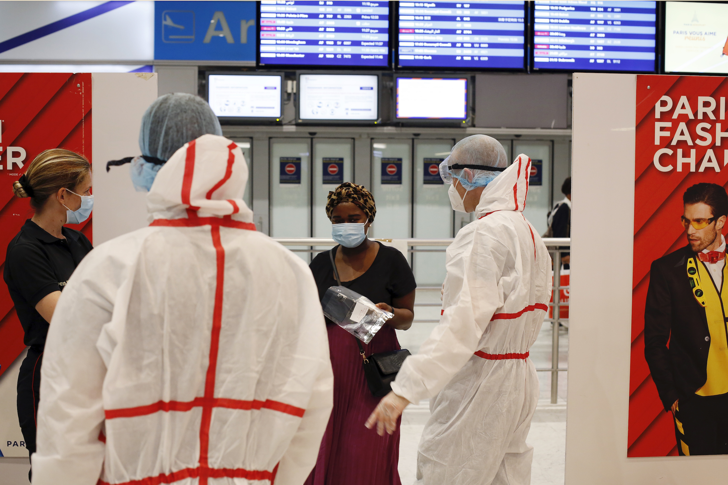 A passenger arrives to be tested with the COVID-19 test, at the Roissy Charles de Gaulle airport, outside Paris on Aug. 1, 2020.