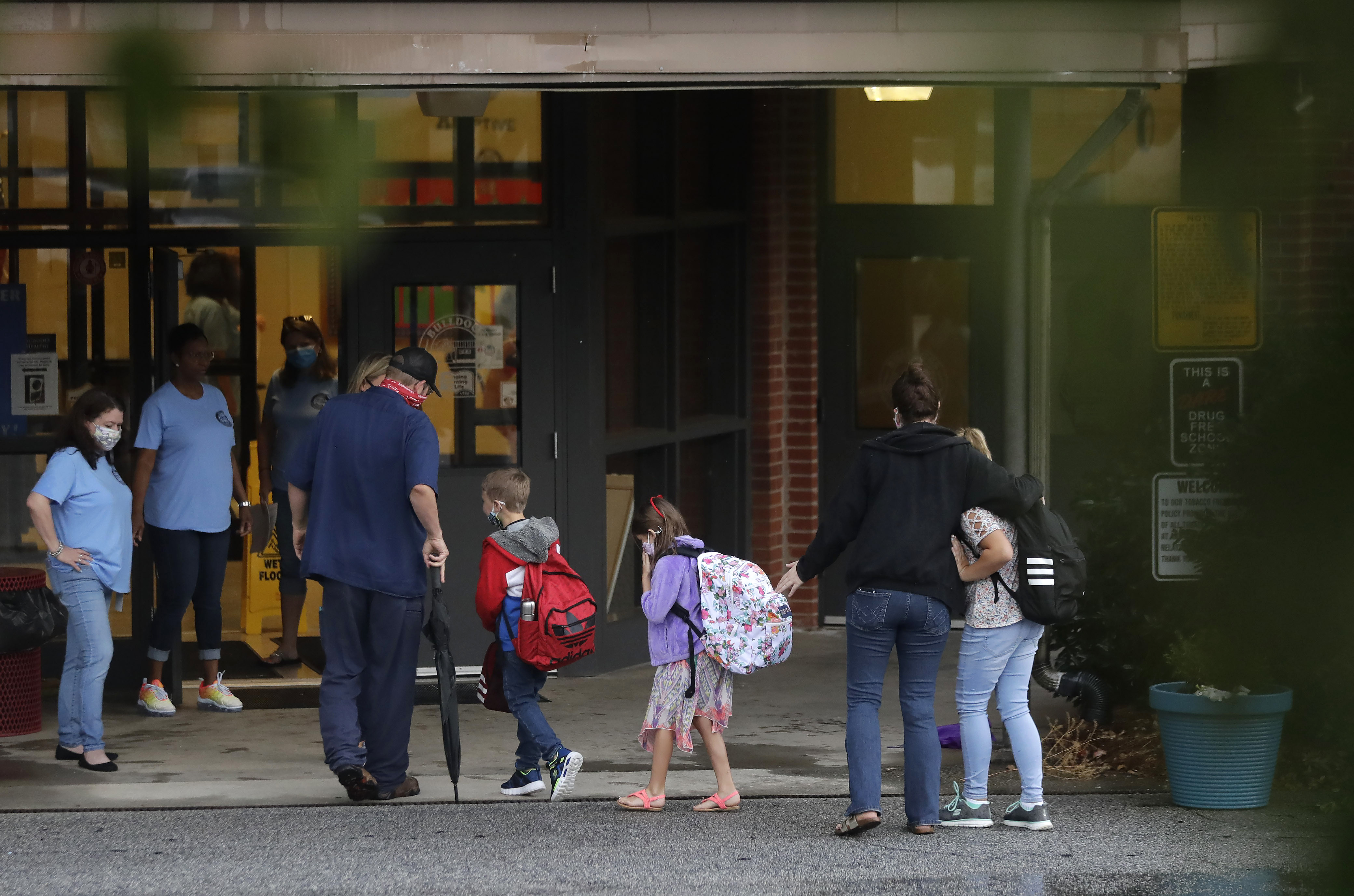 Students arrive to Dallas Elementary School for the first day of school amid the coronavirus outbreak on Aug. 3, 2020, in Dallas, Ga.