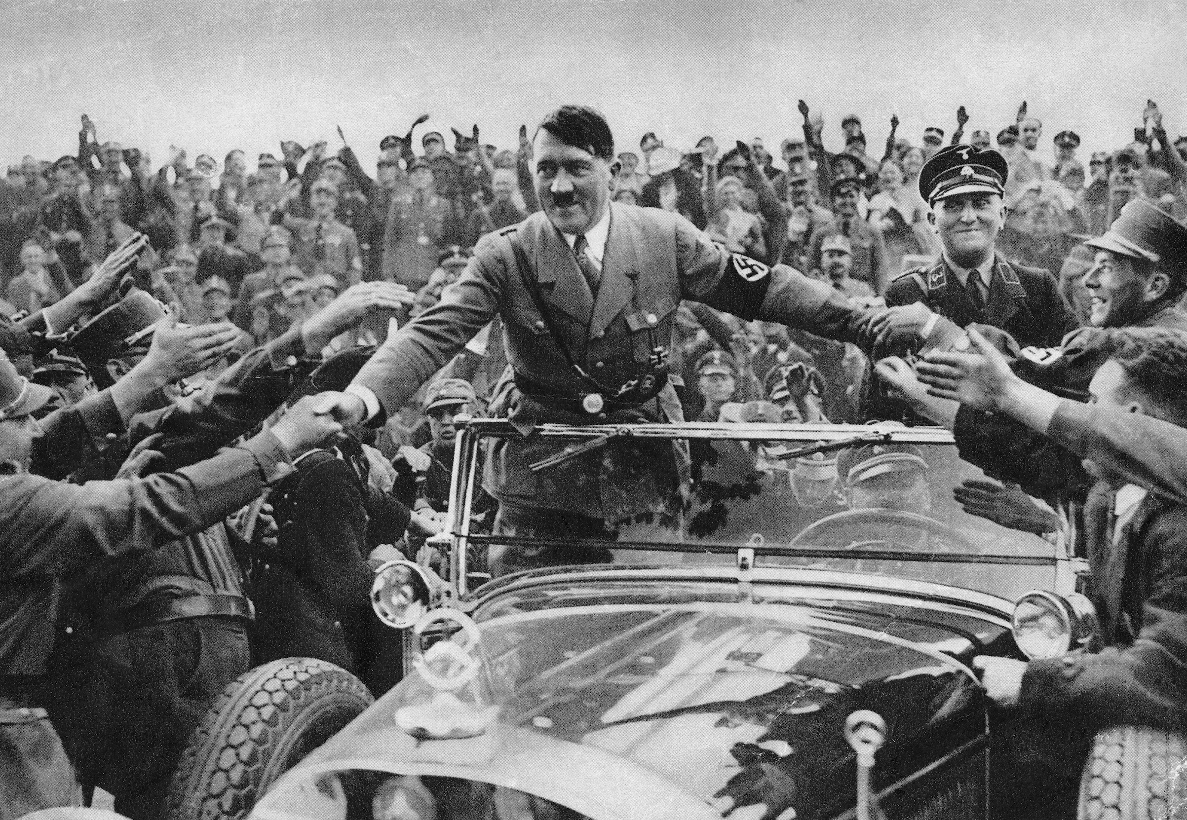 Adolf Hitler is welcomed by supporters at Nuremberg in 1933