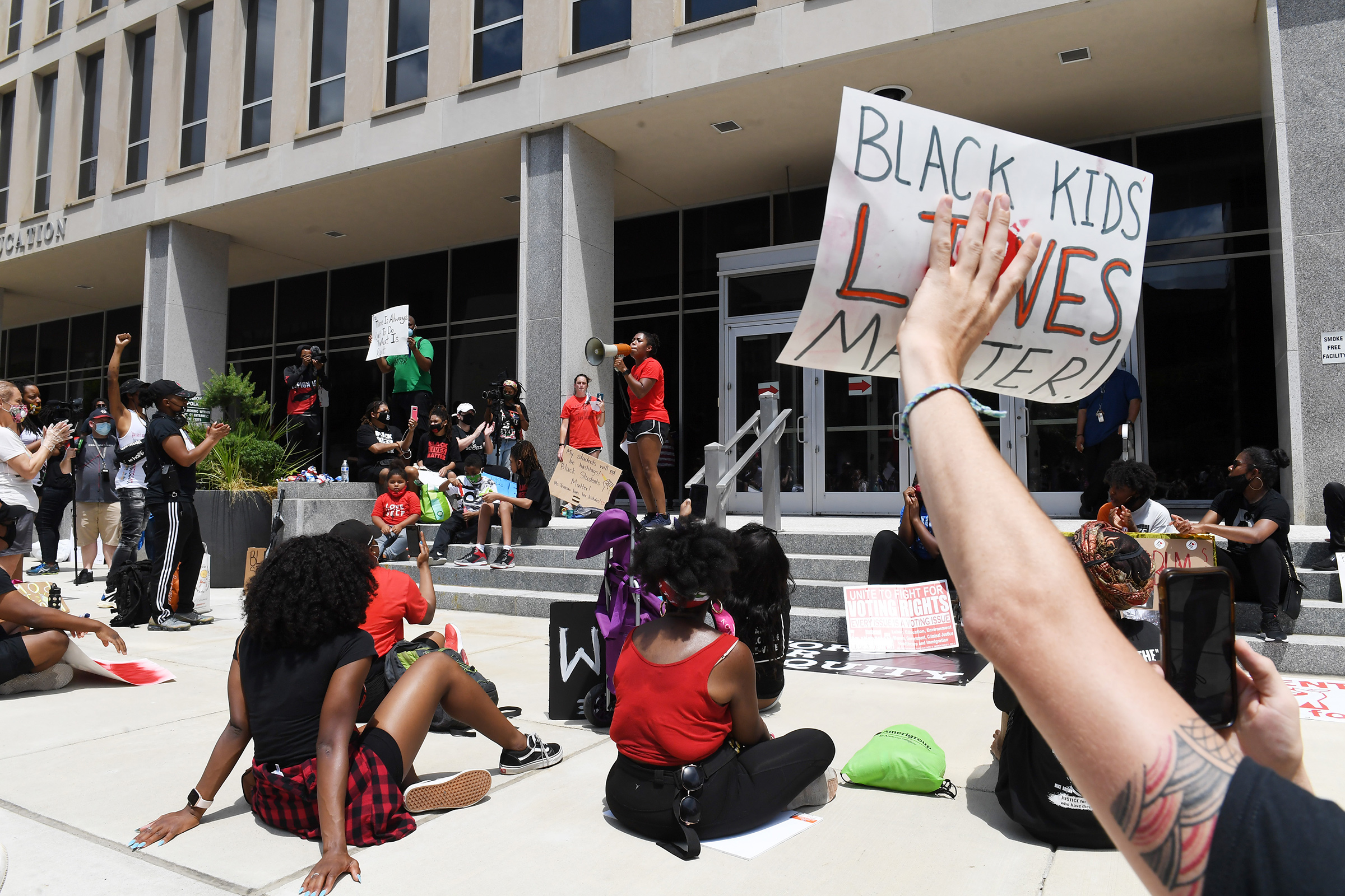 Demonstrators gather outside the U.S. Department of Education for the Black Students Matter march, organized by Educators for Equity on June 19 in Washington, DC.