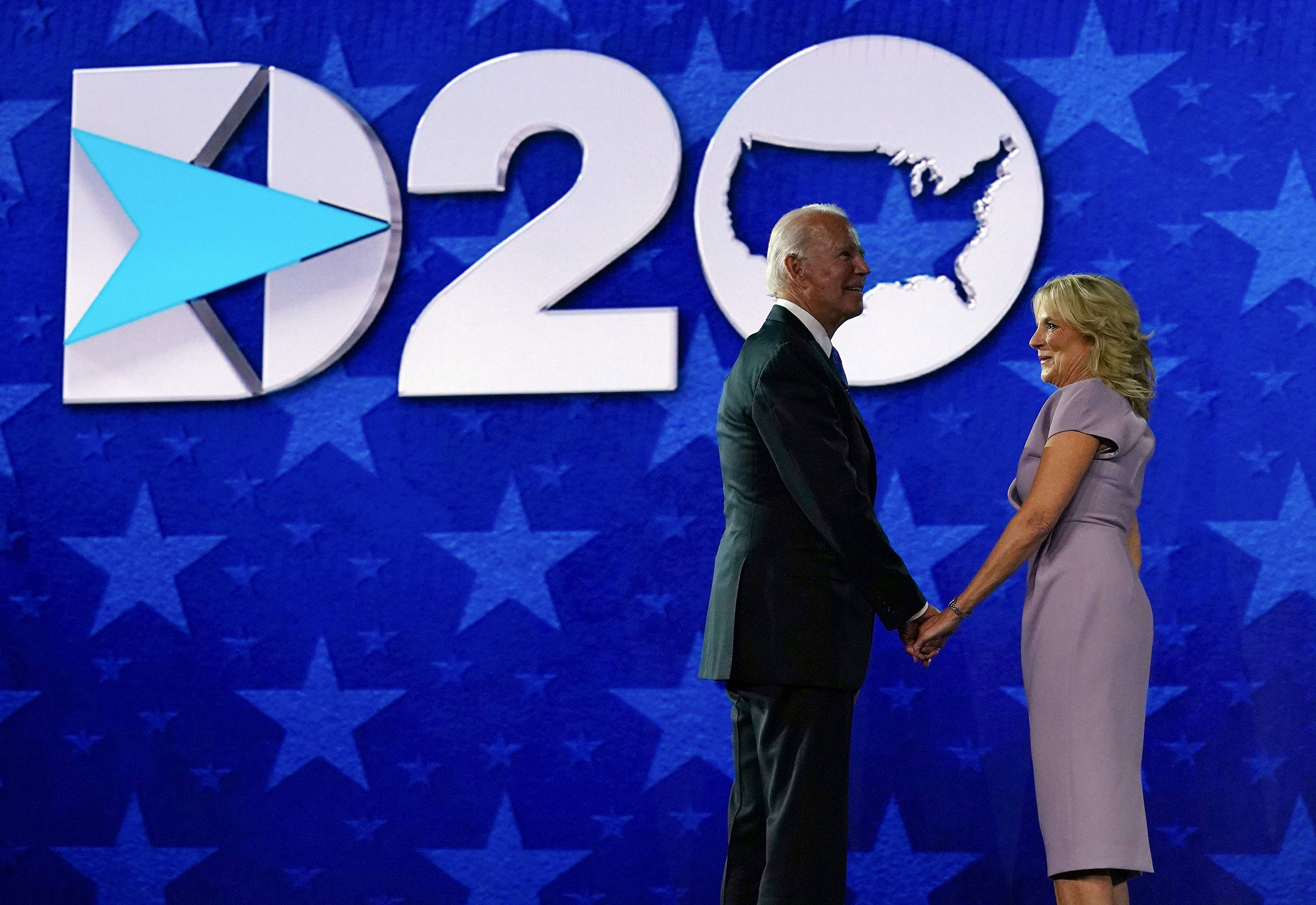 Former vice-president and Democratic presidential nominee Joe Biden and his wife Jill Biden stand on stage after he accepted the Democratic Party nomination for US president during the last day of the Democratic National Convention, being held virtually amid the novel coronavirus pandemic, at the Chase Center in Wilmington, Delaware on Aug. 20, 2020.
