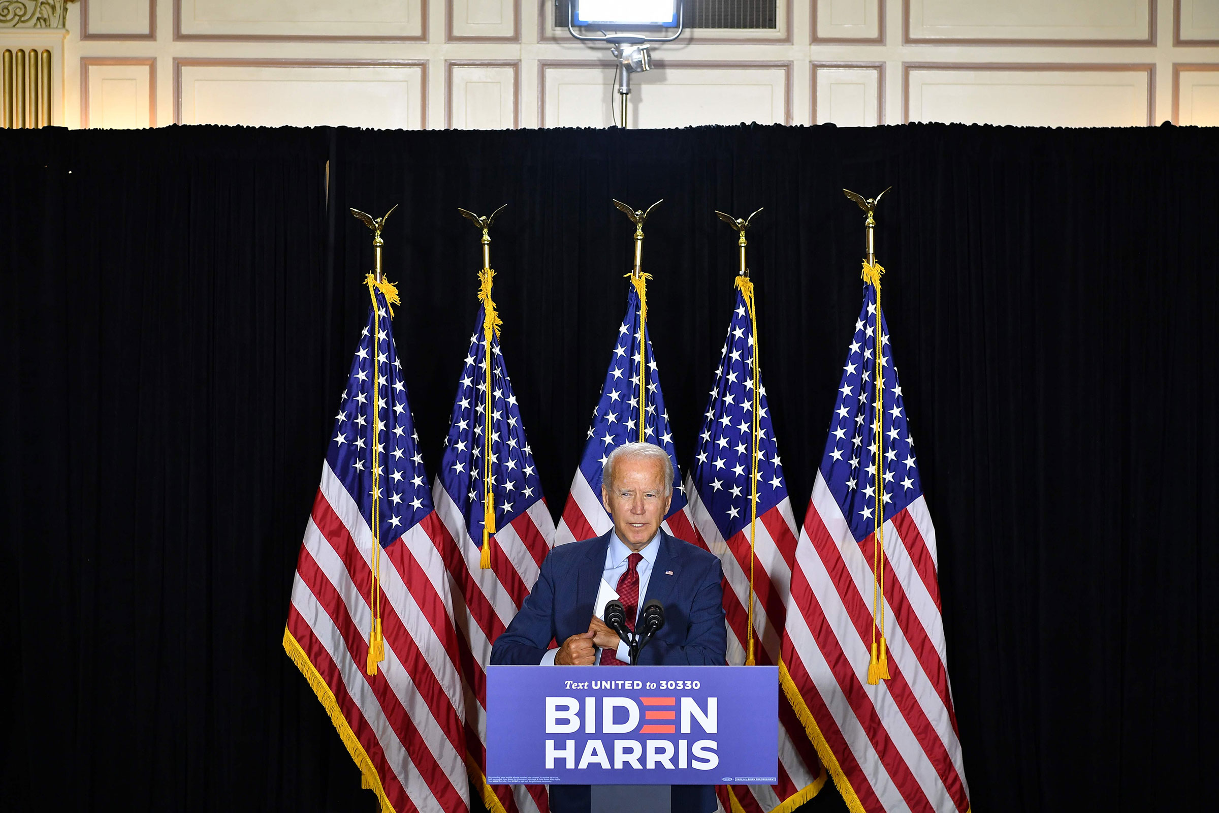 Democratic presidential nominee, former US Vice President Joe Biden, speaks to the press after receiving a briefing on COVID-19 in Wilmington, Delaware, on Aug. 13, 2020.