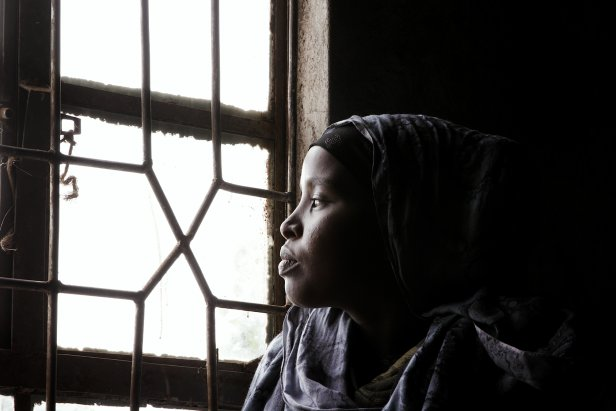 "This frame grab from a video taken for TIME on 15 March 2020, shows Gumato Kuni lookng outside the window of her home in Marsabit. She is a child bride whose parents married her when she was 15 years old after her family's livestock were devastated by severe drought: ""I dropped out of school to get married because of the drought. My parents told me we are poor all our animals are dead we will get livestock if we marry you... And I was married off."