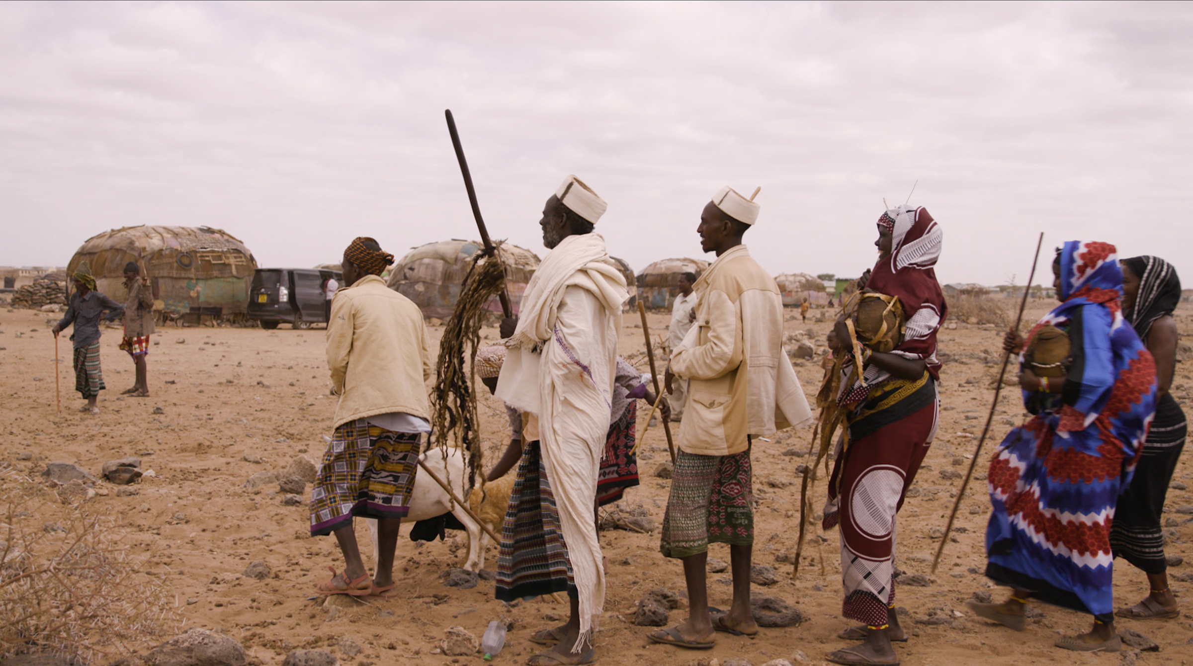 Gabra men carrying gifts before a wedding. The groom's family will present gifts to the bride's father, including a dowry of three camels, in Marsabit county, Kenya, on March 14, 2020.