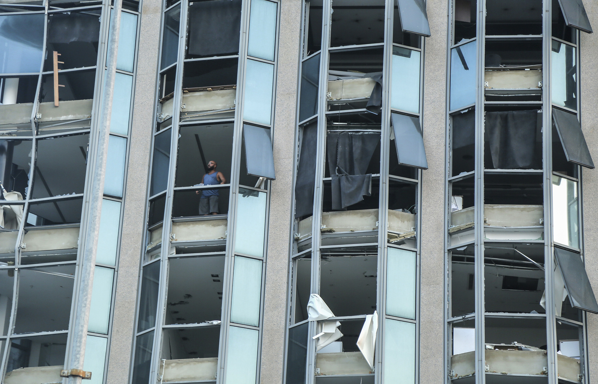 The facade of a building is shattered following a massive explosion in Beirut's port.