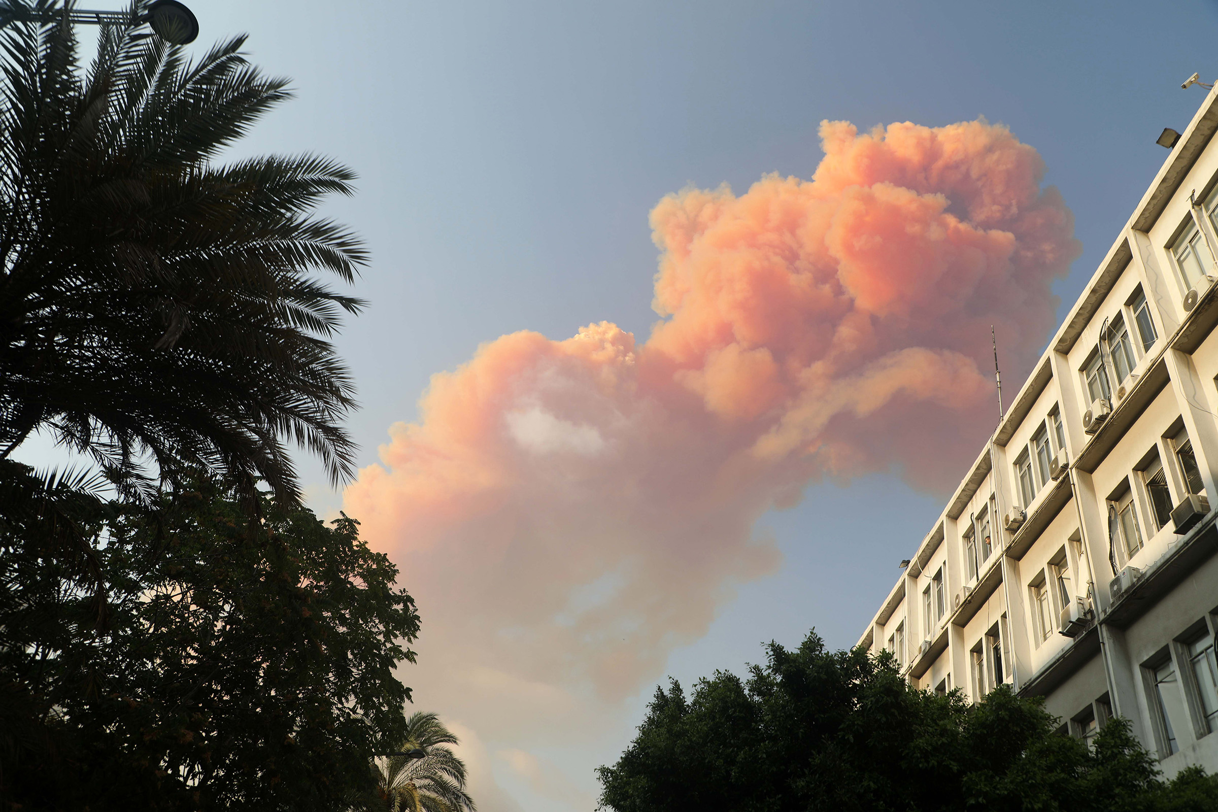 Pink smoke rises following the explosion.