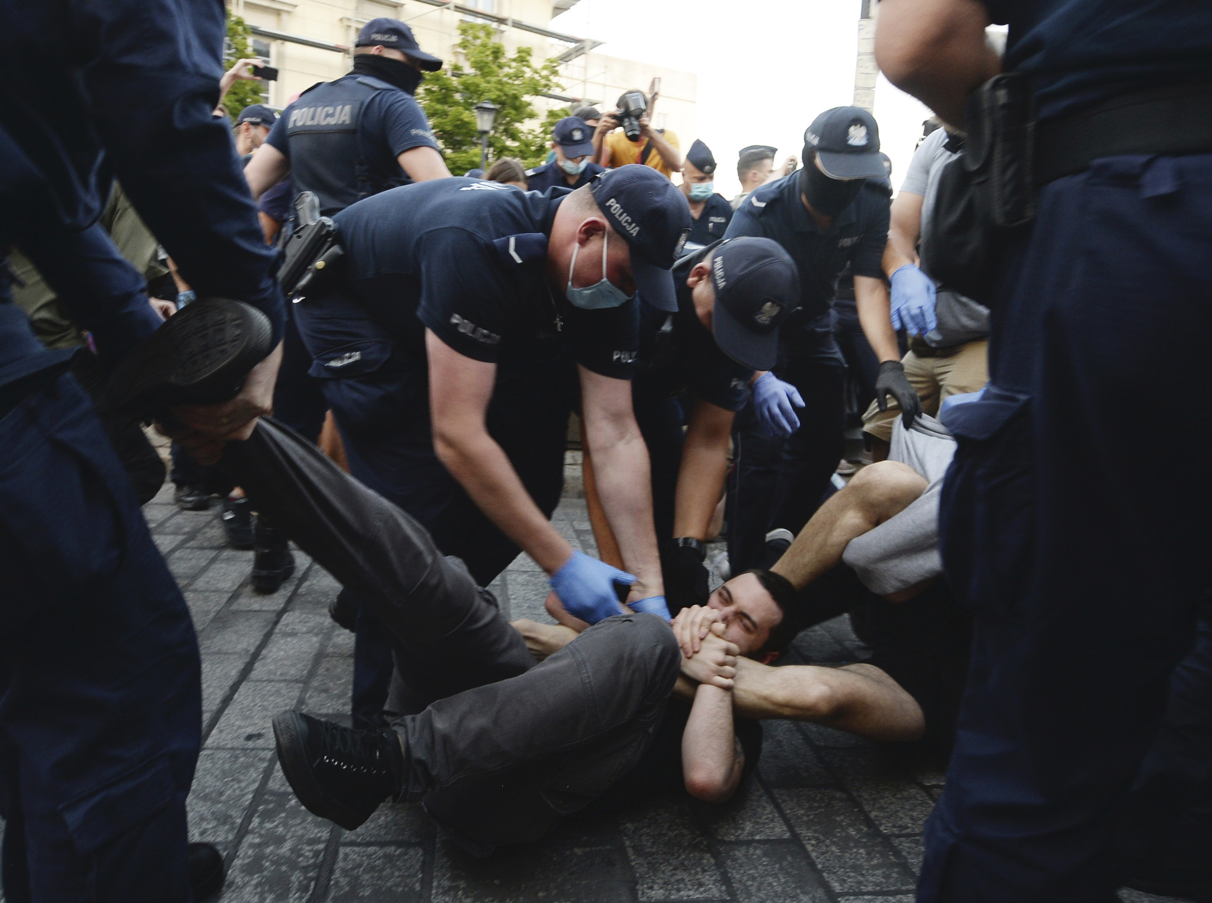 Police scuffle with pro-LGBT protesters angry at the arrest of an LGBT activist in Warsaw, Poland on Aug. 7, 2020.
