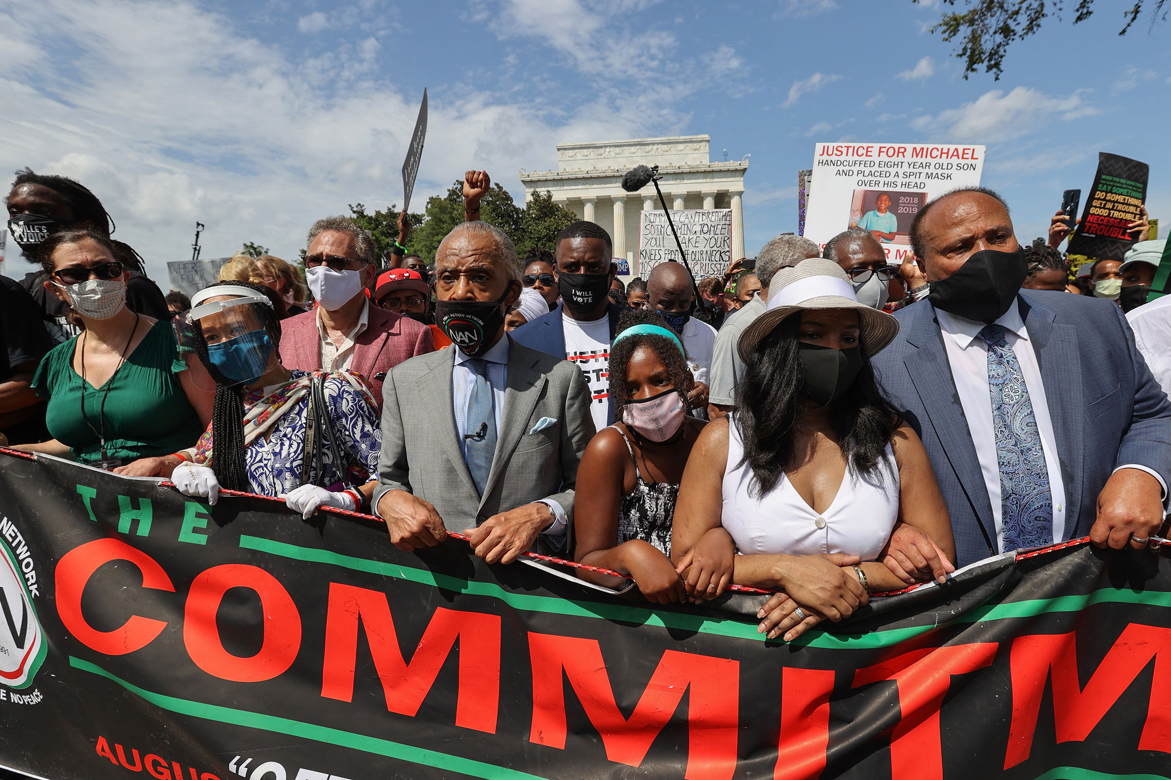 Rev. Al Sharpton, center, marches next to Yolanda King, Andrea Waters King and Martin Luther King, III during the  Commitment March: Get Your Knee Off Our Necks  protest against racism and police brutality, in Washington, D.C., on Aug. 28, 2020.