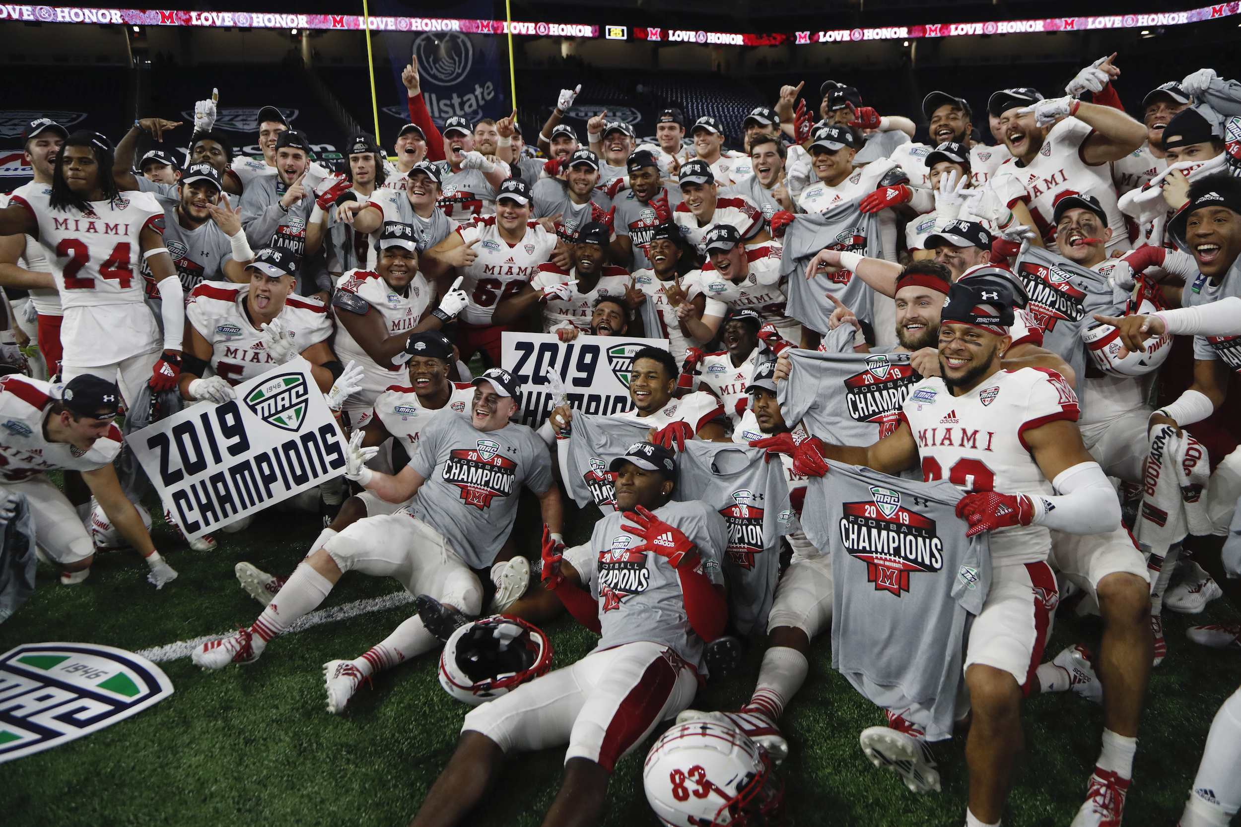 Members of the Miami of Ohio team pose on the field after the Mid-American Conference championship NCAA college football game against Central Michigan, on Dec. 7, 2019, in Detroit.