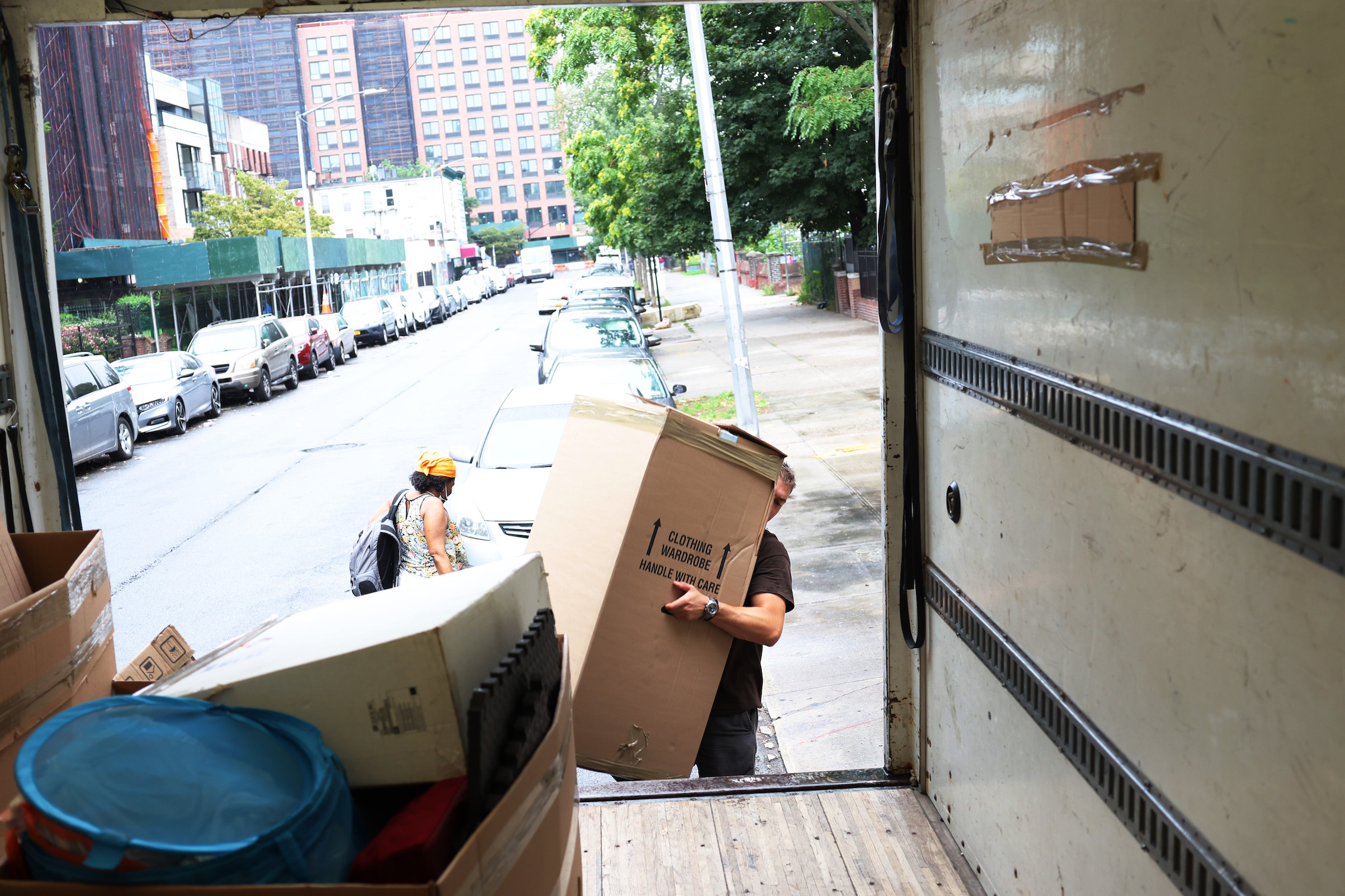 A mover with Rabbit Movers places the belongings of a customer unto a moving truck on Aug. 13, 2020 in New York City. Moving companies are increasingly trying to keep up with higher demand as an uptick of people are choosing to move from New York City during the COVID-19 pandemic.