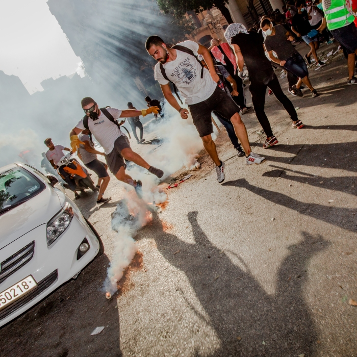 Smoke billows from a tear gas canister during a mass demonstration in Beirut on Aug. 8, four days after the blast.