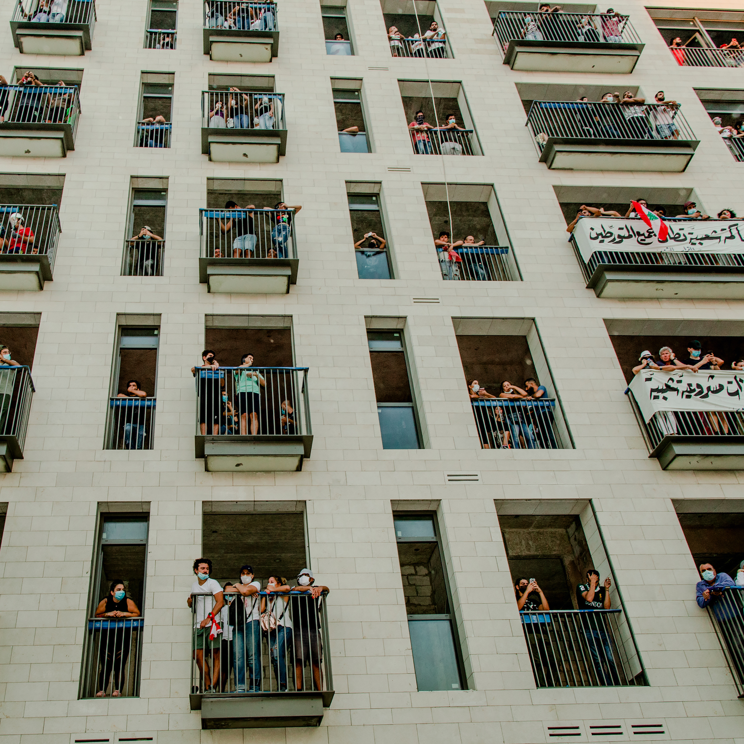 People gather on balconies during the demonstration. Protesters say negligence and corruption across Lebanon's political system contributed to the disaster.