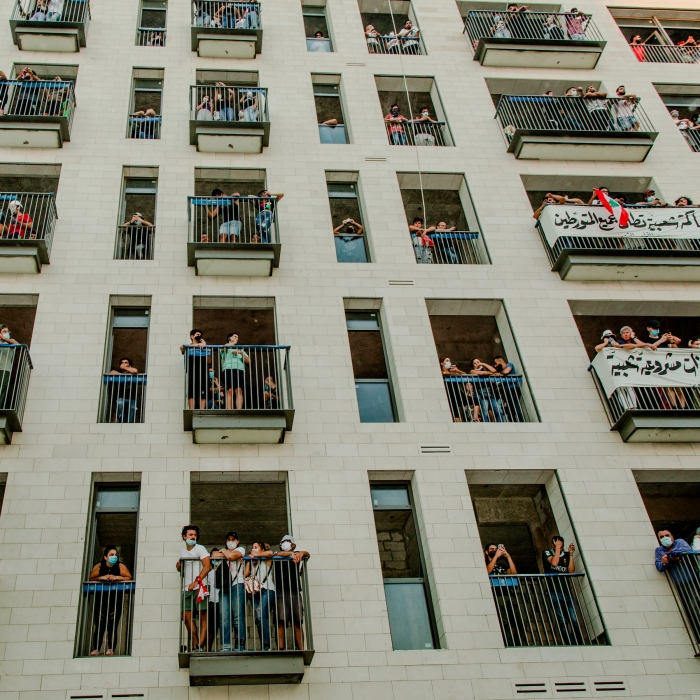 People gather on balconies during the Aug. 8 demonstration. Protesters say negligence and corruption across Lebanon's political system contributed to the port disaster.