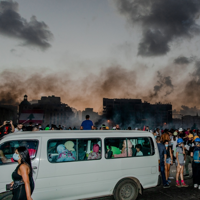 A group of women inside a van avoid thick clouds of tear gas in Beirut on Aug. 8.