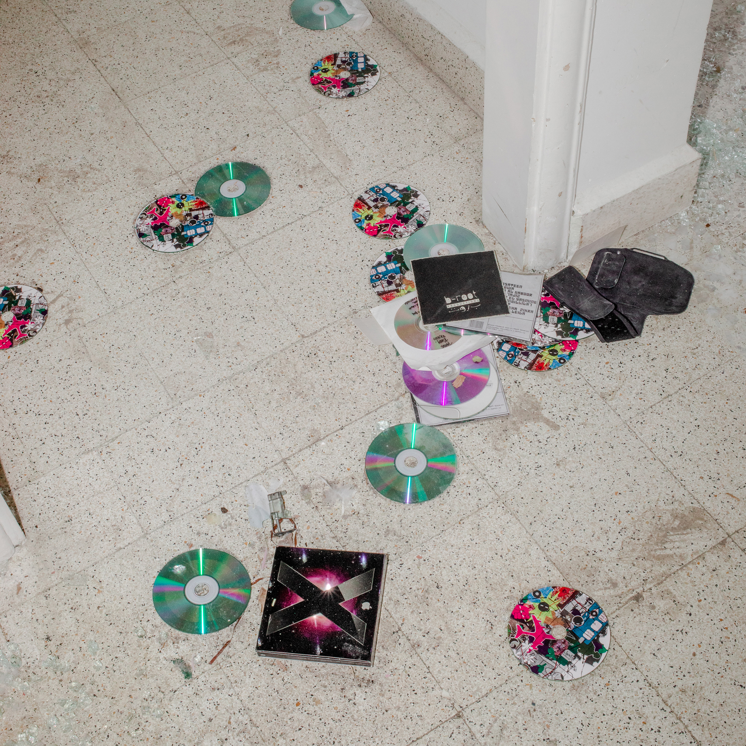 CDs are scattered on the floor of music producer Jana Saleh's apartment, which was heavily damaged by the port explosion and blast wave.  I Google-mapped the distance between the blast and my home. It's approximately two kilometers (1.24 mi.). We managed to hide in the glassless bathroom right on time and survived it,  says Saleh.  The concept is a thing of the 80s, during the civil war. The kids and the valuables were hidden in the bathroom. My brother and I spent a lot of time in it. On Aug. 4, I dragged my girlfriend to it. She's the valuable in this story.