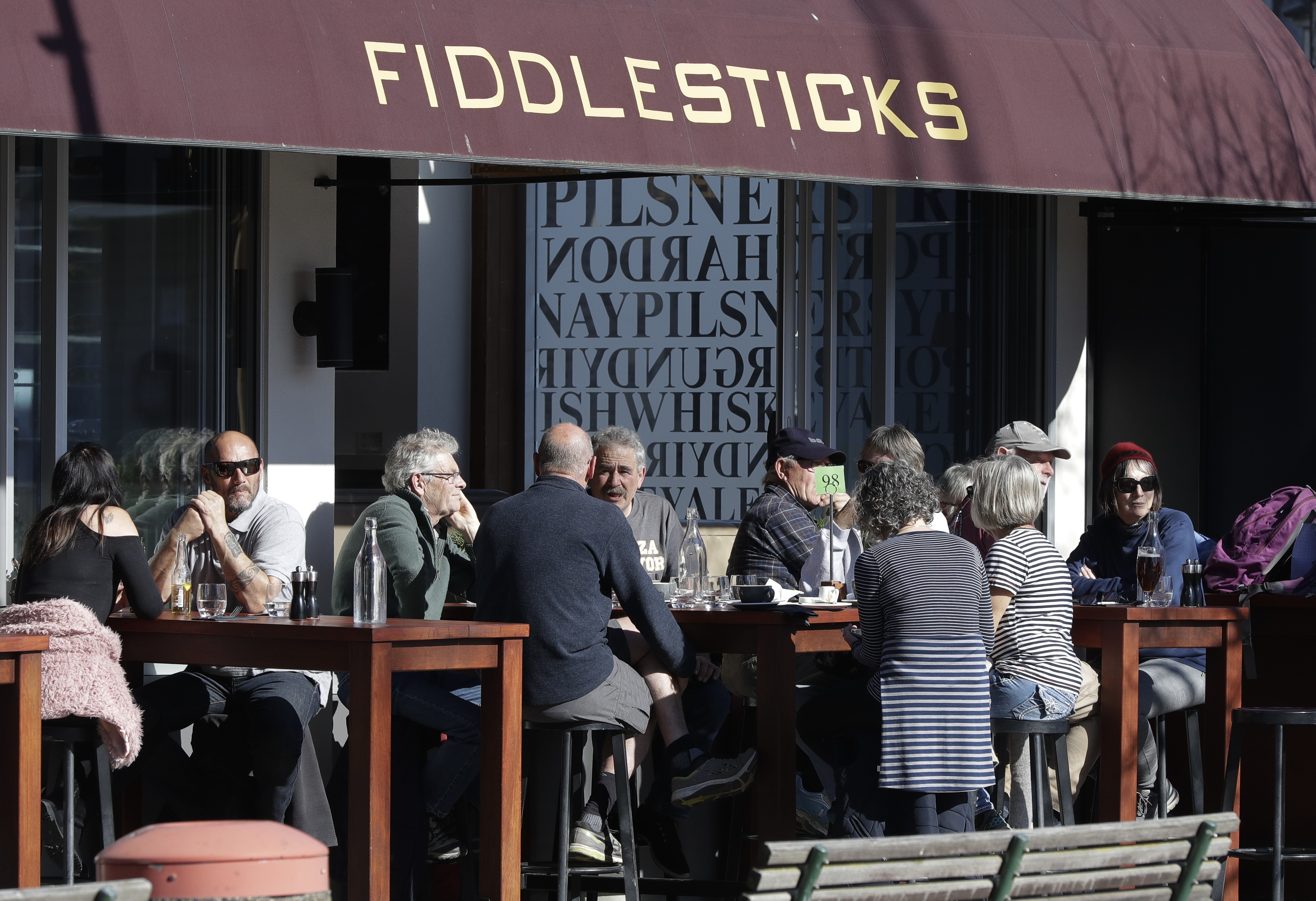 Customers at a cafe enjoy lunch in the sunshine in Christchurch, New Zealand, Aug. 9, 2020.