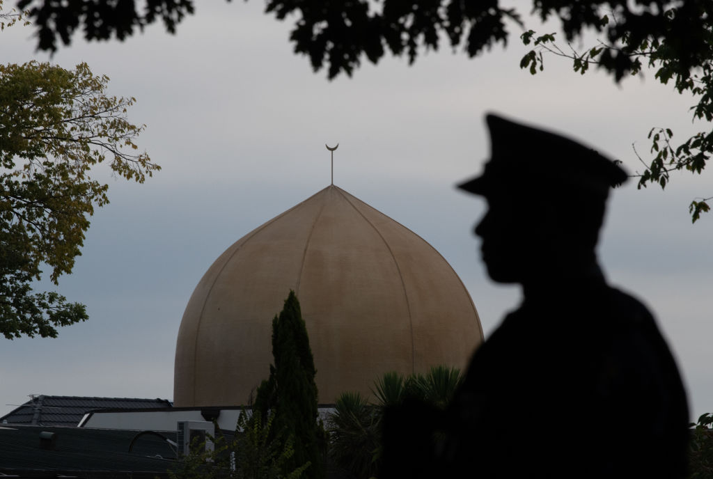 A police officer stands guard near Al Noor mosque in Christchurch, New Zealand on March 18, 2019.
