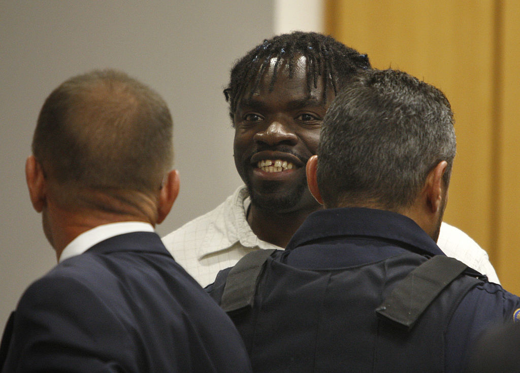 Death row inmate Marcus Robinson smiles toward his family after a judge found that racial bias played a role in his  sentencing on April 20, 2012, in Fayetteville, North Carolina.