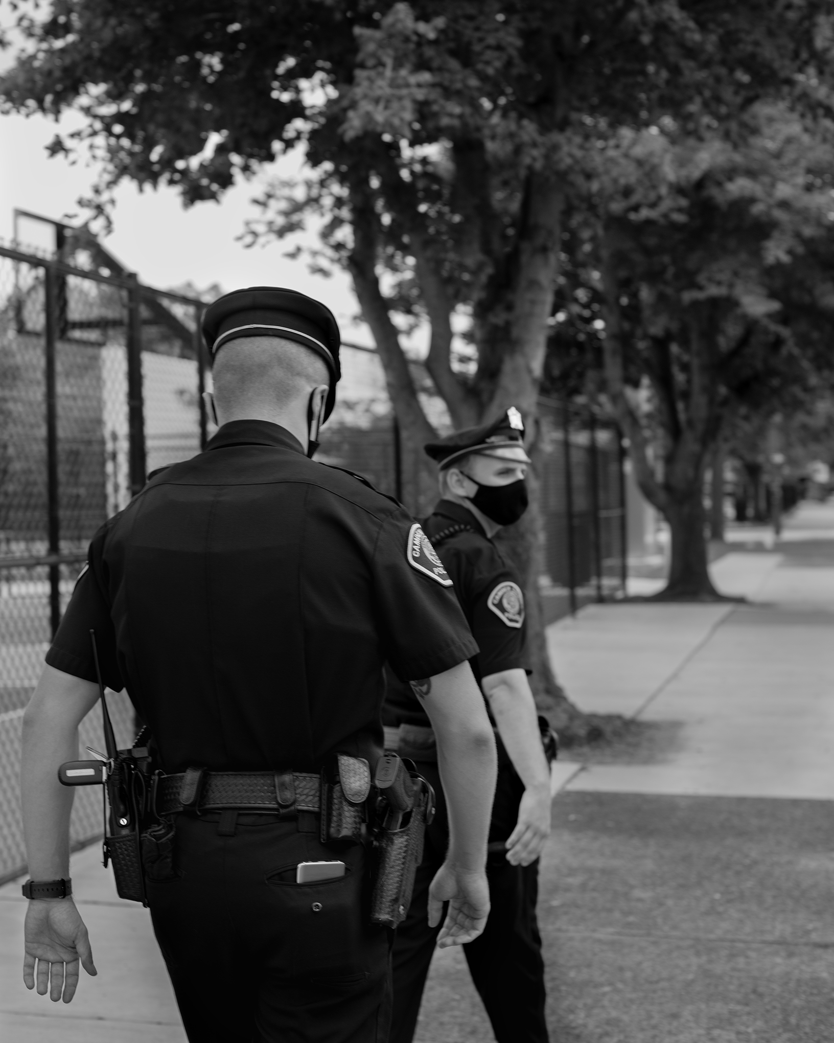In 2013, when the Camden Police department relaunched under county control, it had two main objectives: reduce the crime rate, and make citizens feel safer. Above, two officers patrol the streets of the city on July 17.