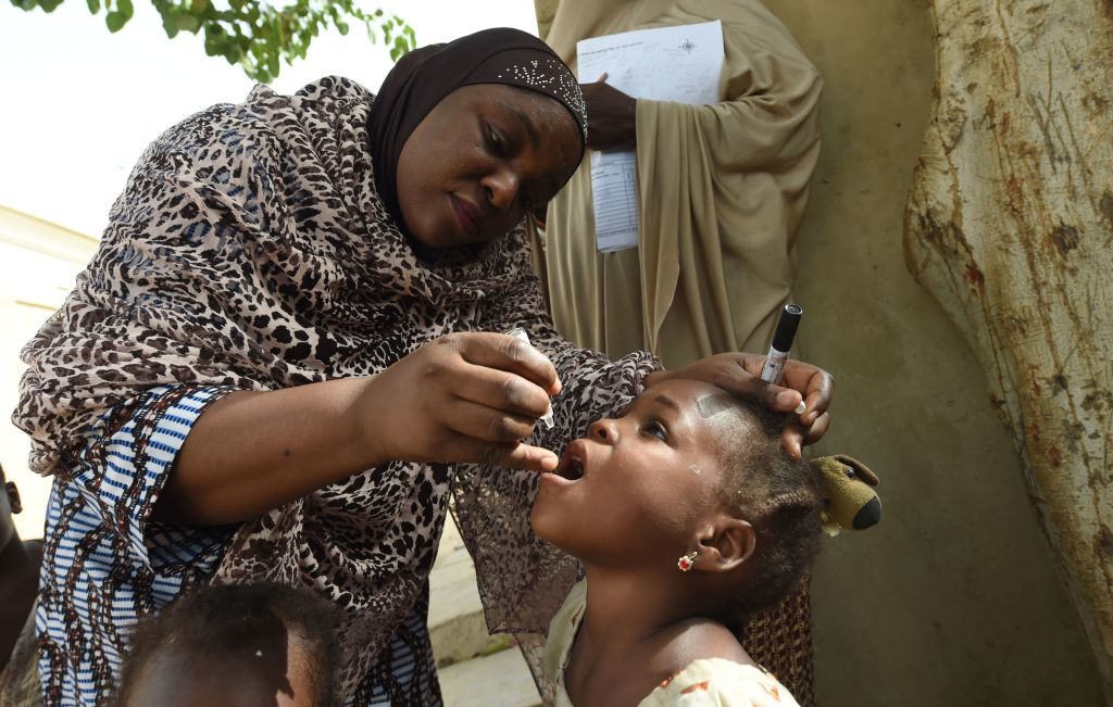 UNICEF health consultant Hadiza Waya immunizes a child during a polio vaccination campaign on April 22, 2017, in Kano, Nigeria.