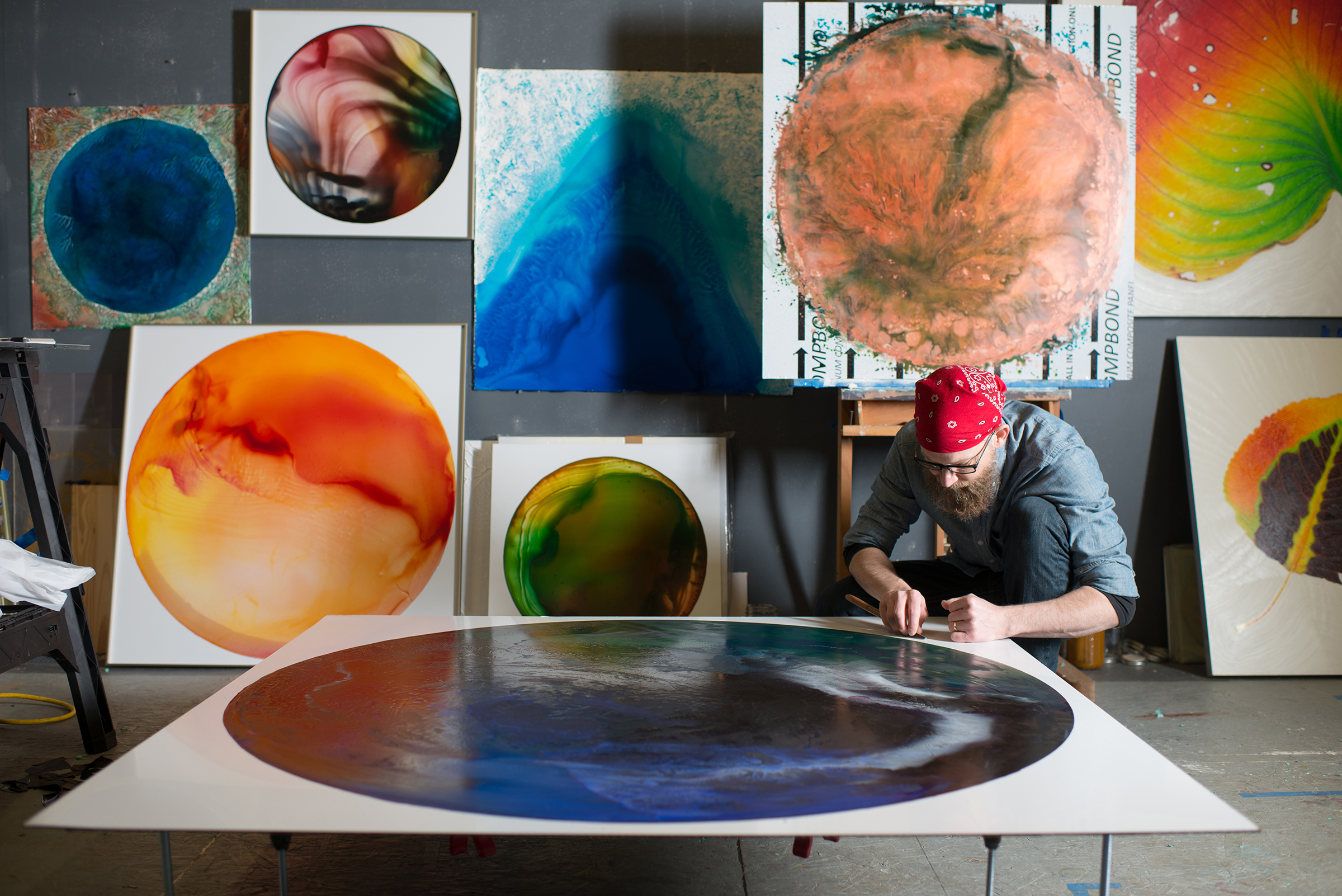 John Sabraw painting in his studio, in Athens, Ohio in 2018.