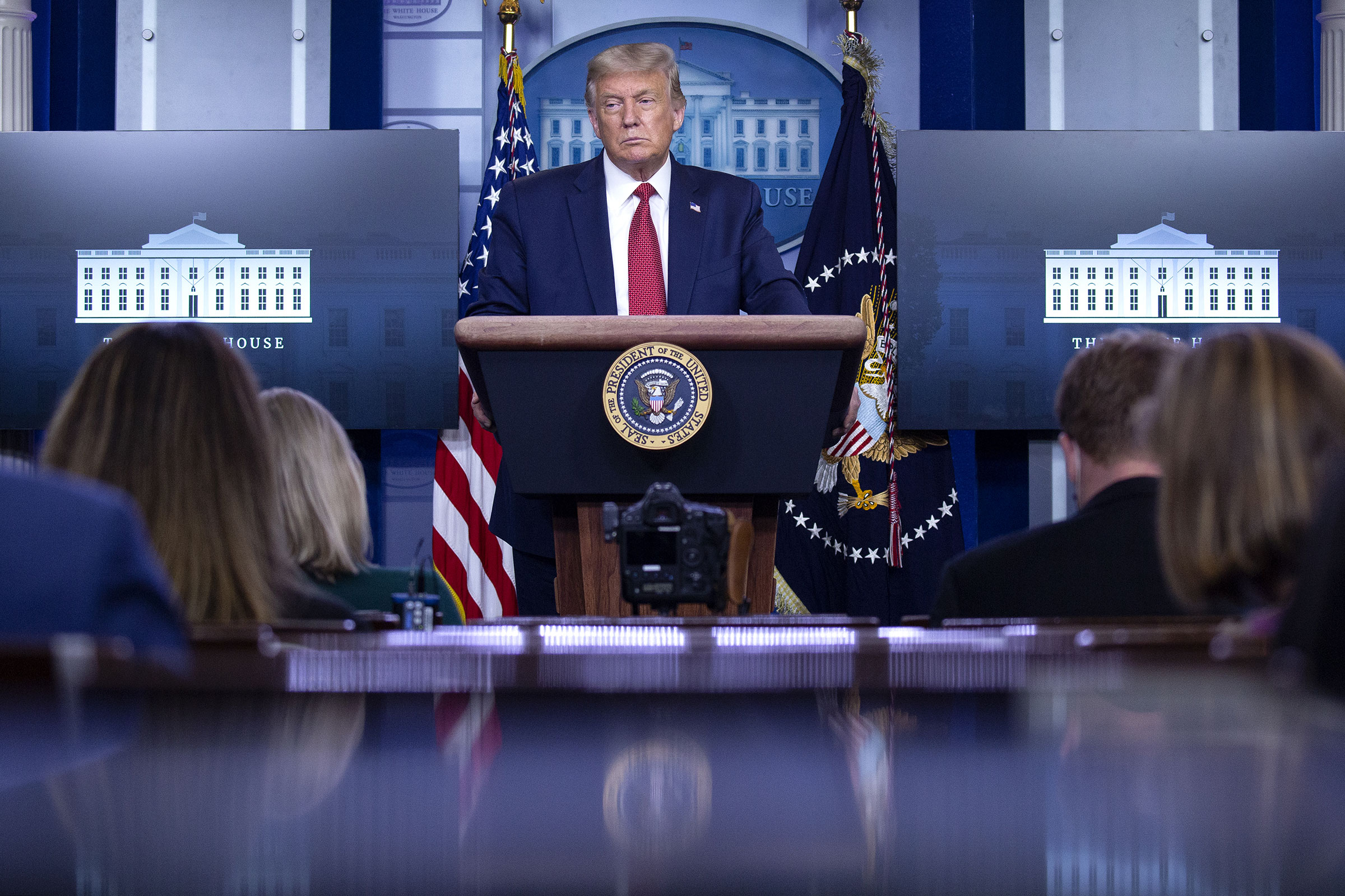 President Donald Trump listens during a news conference in the White House Press Briefing Room on Aug. 10, 2020.