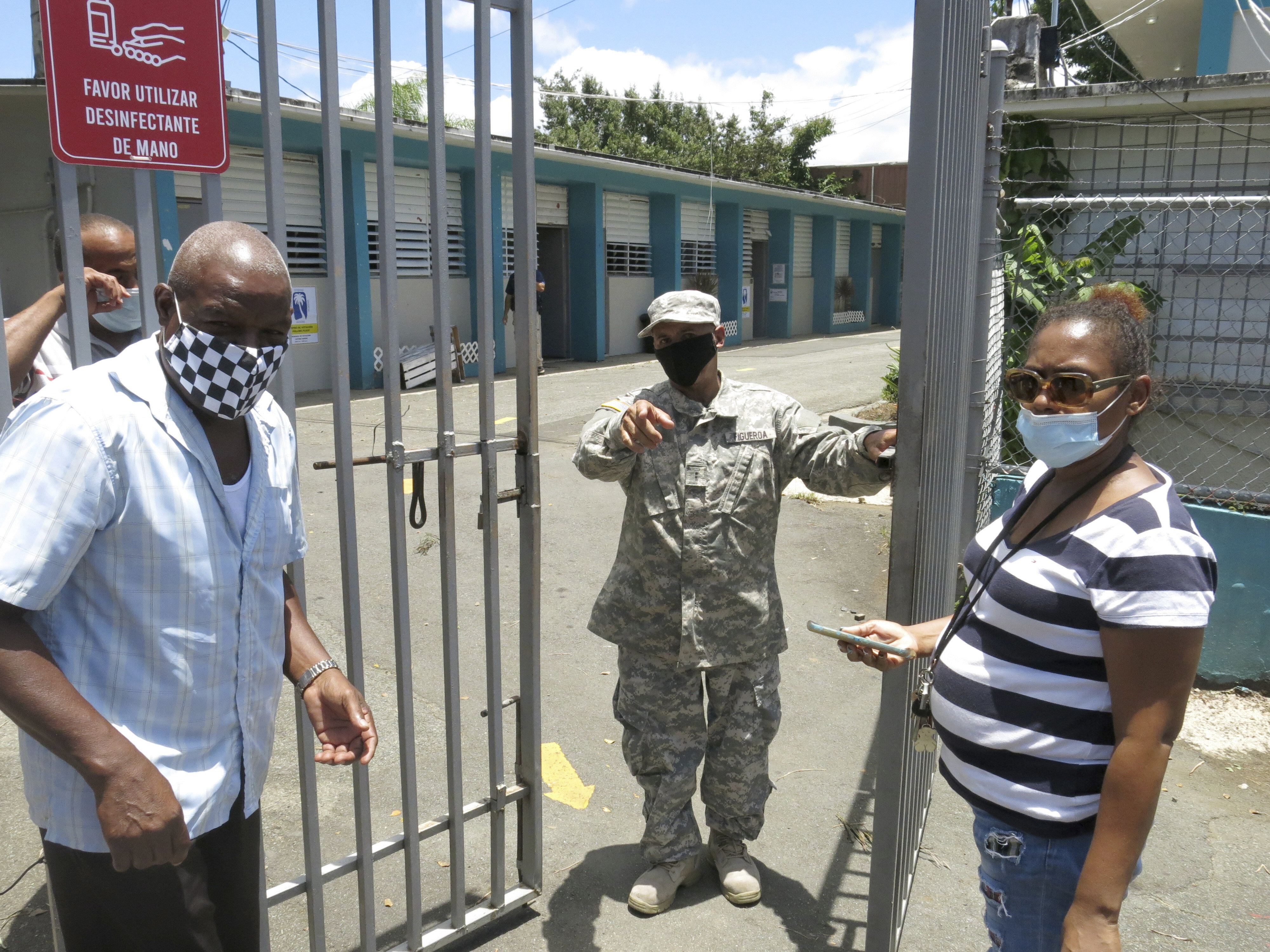 An official turns away two voters at a voting center lacking ballots in Carolina, Puerto Rico, Aug. 9, 2020.
