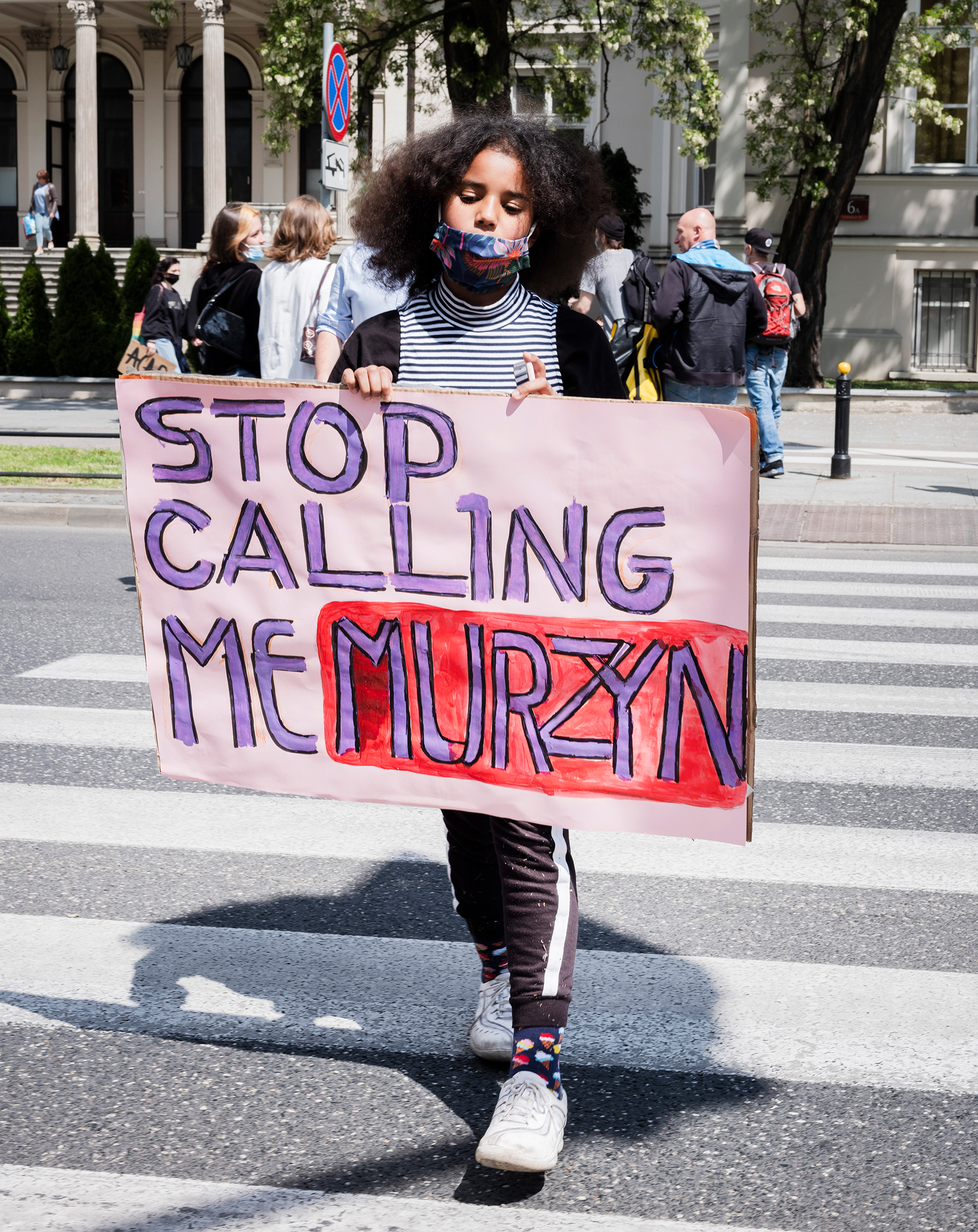 Bianka Nwolisa walks with a sign  Stop Calling Me Murzyn,  during a protest against police brutality in the wake of George Floyd's killing, in Warsaw on June 4, 2020.