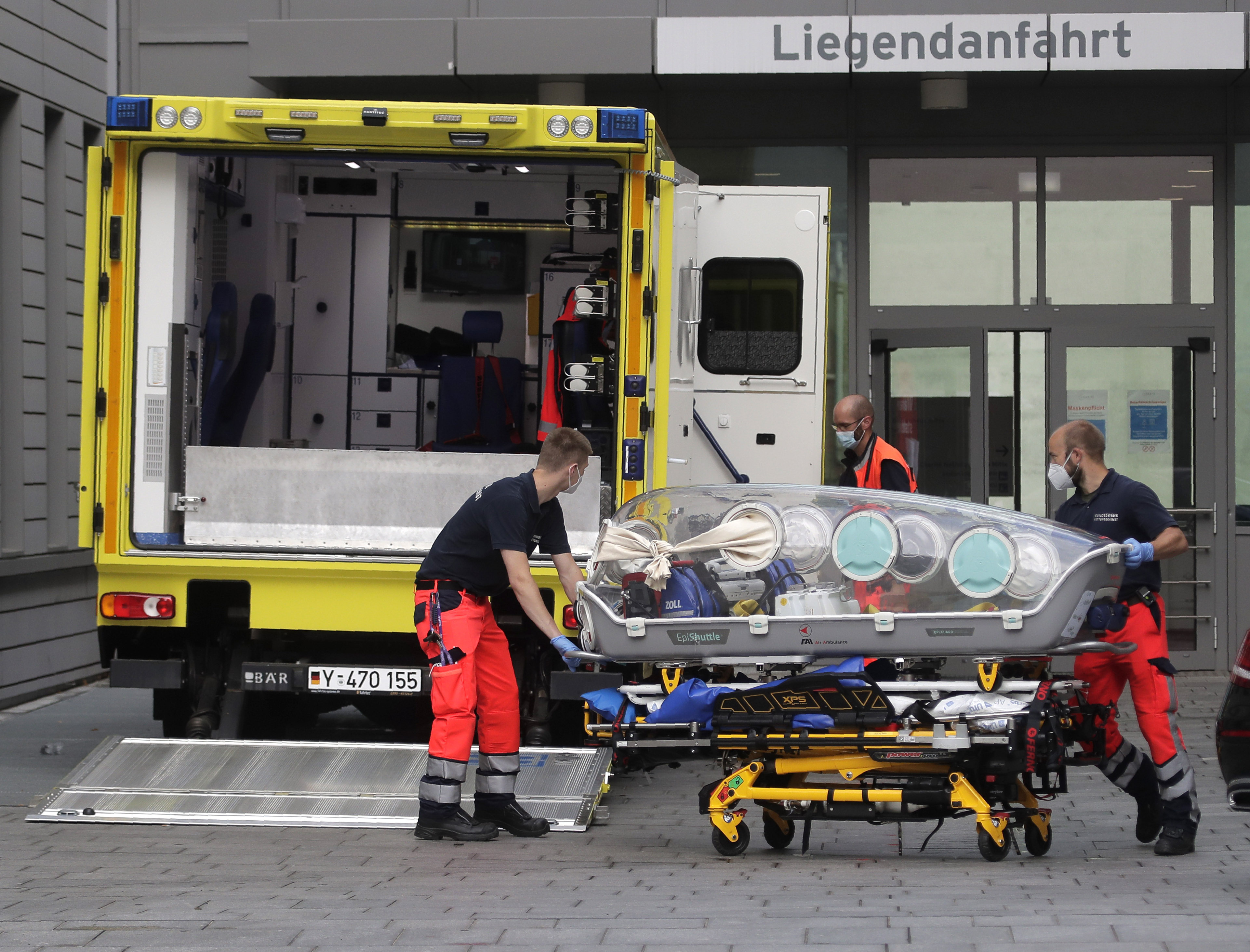 An empty stretcher is carried back into an ambulance which is believed to have transported Alexei Navalny at the emergency entrance of the Charite hospital in Berlin, Germany, Aug.22, 2020.