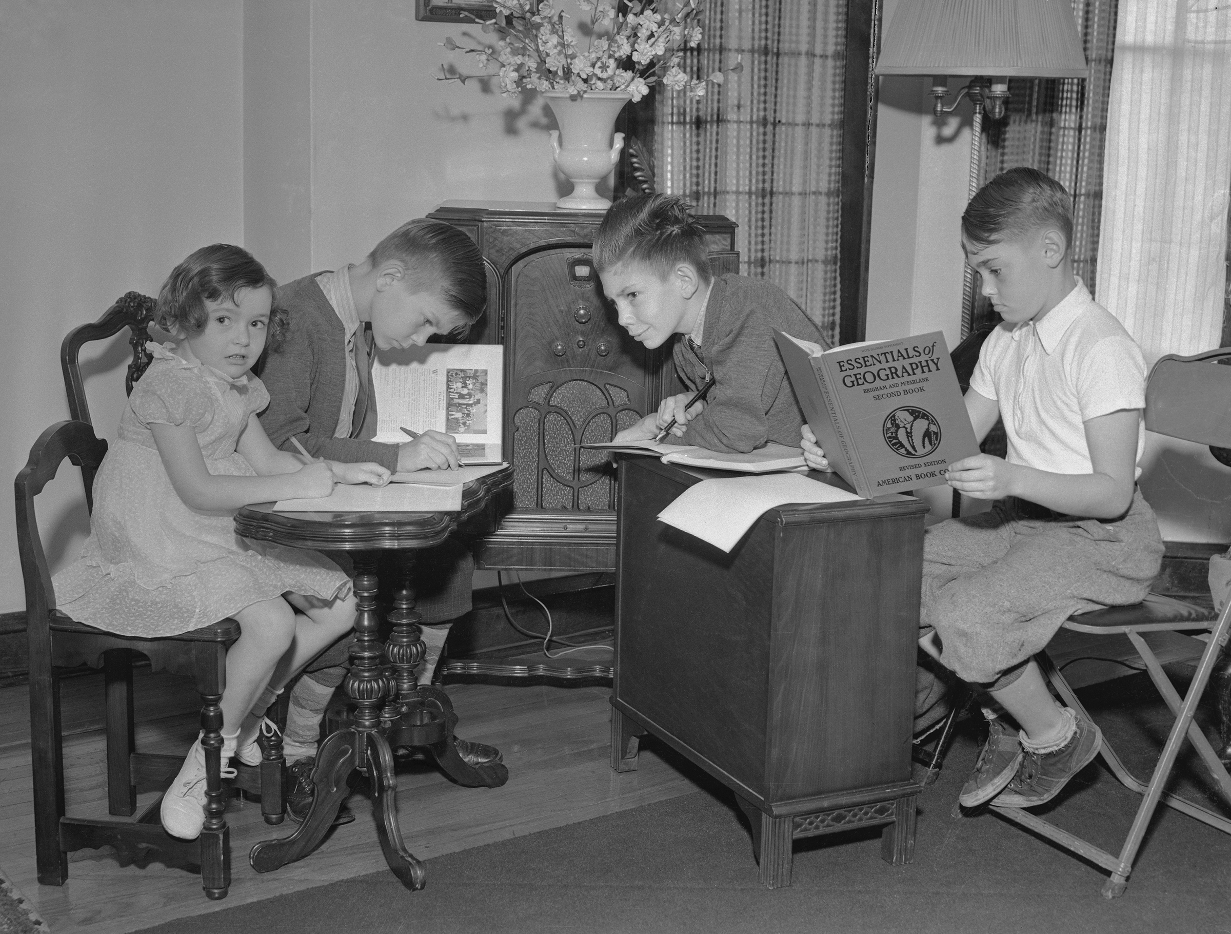 Due to the Infantile Paralysis Epidemic in Chicago, the reopening of schools was delayed. Students listen to a pre-arranged course of study via the radio stations, in accordance with a schedule drawn up by several school principals, on Sept 13, 1937