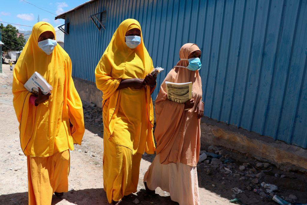 Students wearing face masks walk in a Mogadishu neighborhood on March 19, 2020 in Somalia.