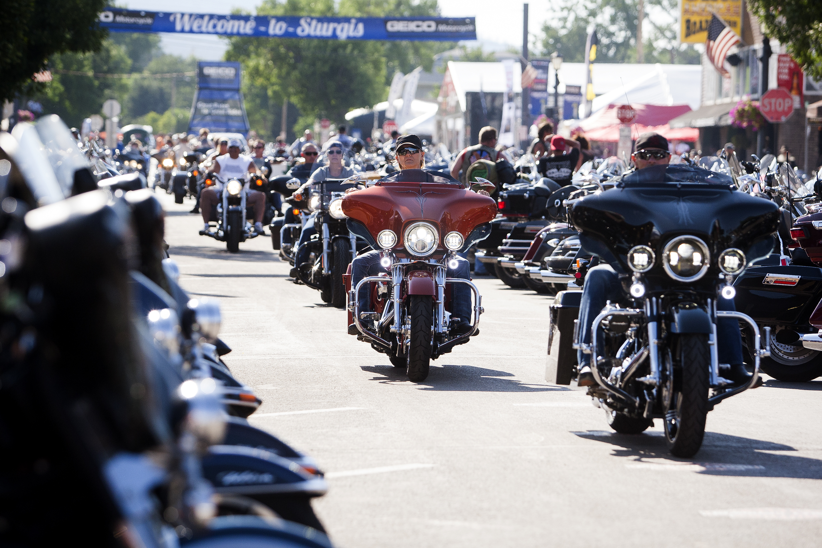 In this Aug. 5, 2016 file photo, bikers ride down Main Street in downtown Sturgis, S.D., before the 76th Sturgis motorcycle rally officially begins.