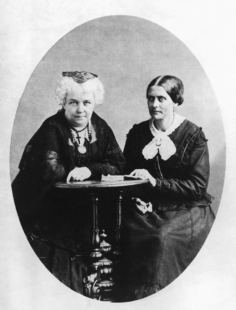 A circa 1881 photograph of Susan B. Anthony and Elizabeth Cady Stanton, founders of The National Woman Suffrage Association, seated together at small table.