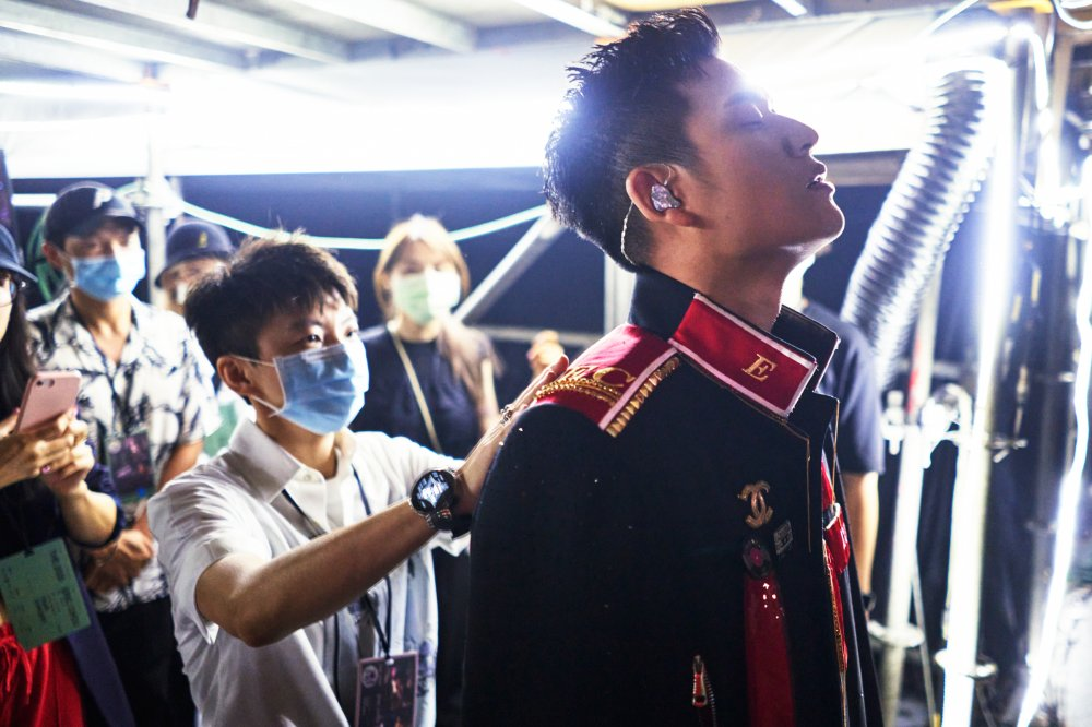 Chou receives finishing touches from his manager Reese Hsu before going onstage