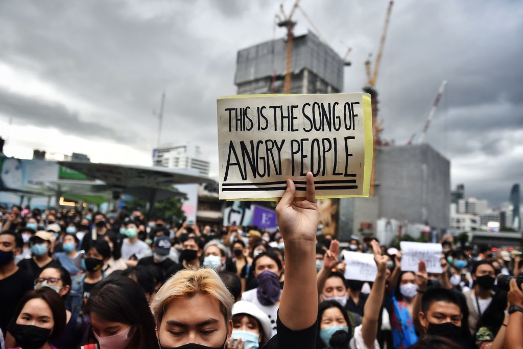 Protesters call for the dissolution of the military-backed government during a flash mob in Bangkok, Thailand on Aug. 8, 2020.