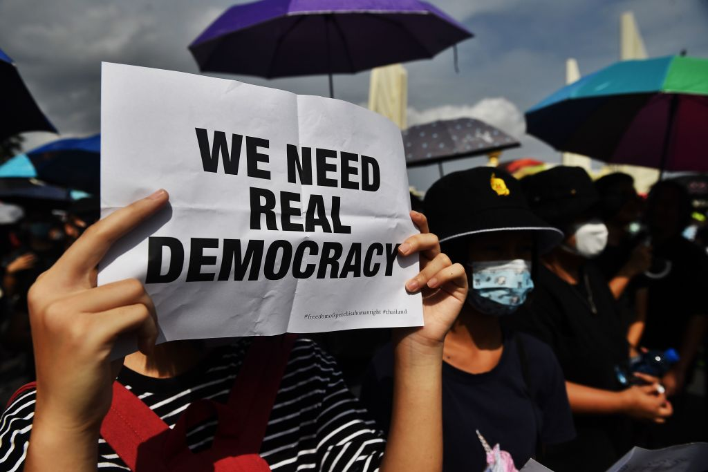A protester holds up a sign at a rally in Bangkok, Thailand on Aug. 16, 2020.