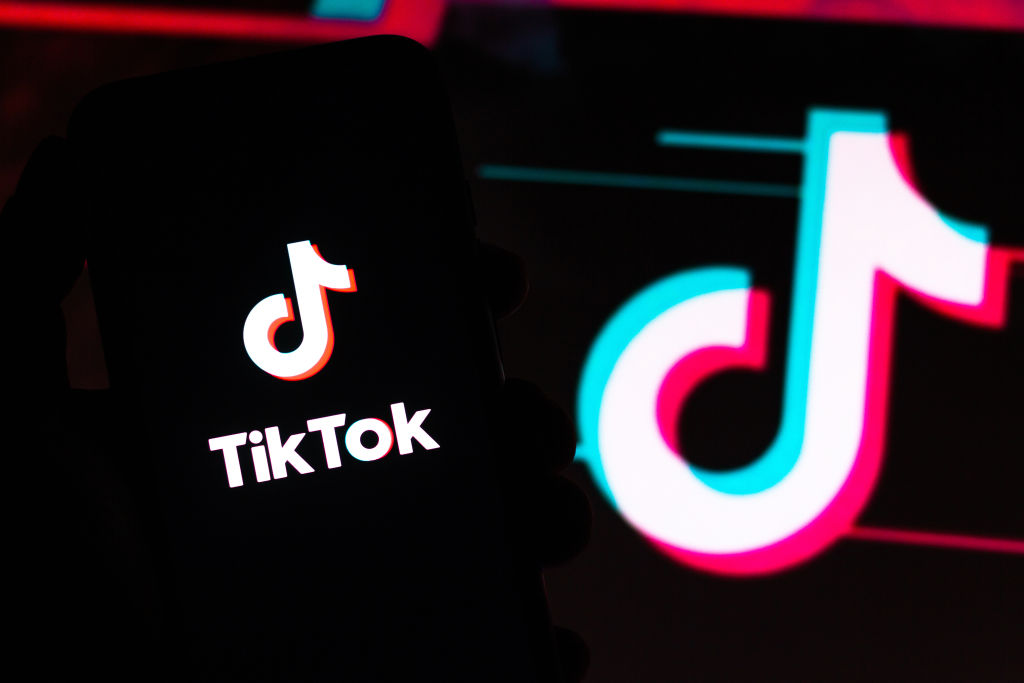 In this photo illustration a TikTok logo seen displayed on a smartphone.