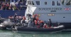 A Border Force vessel brings a group of people thought to be migrants into the port city of Dover, England, from small boats on Aug. 8, 2020.