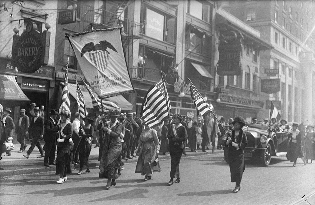 Members of the National American Woman Suffrage Association marching from Pennsylvania Terminal to their headquarters on Aug. 28, 1920, after welcoming home Carrie Chapman Catt, president of the Association, on her arrival from Tennessee.