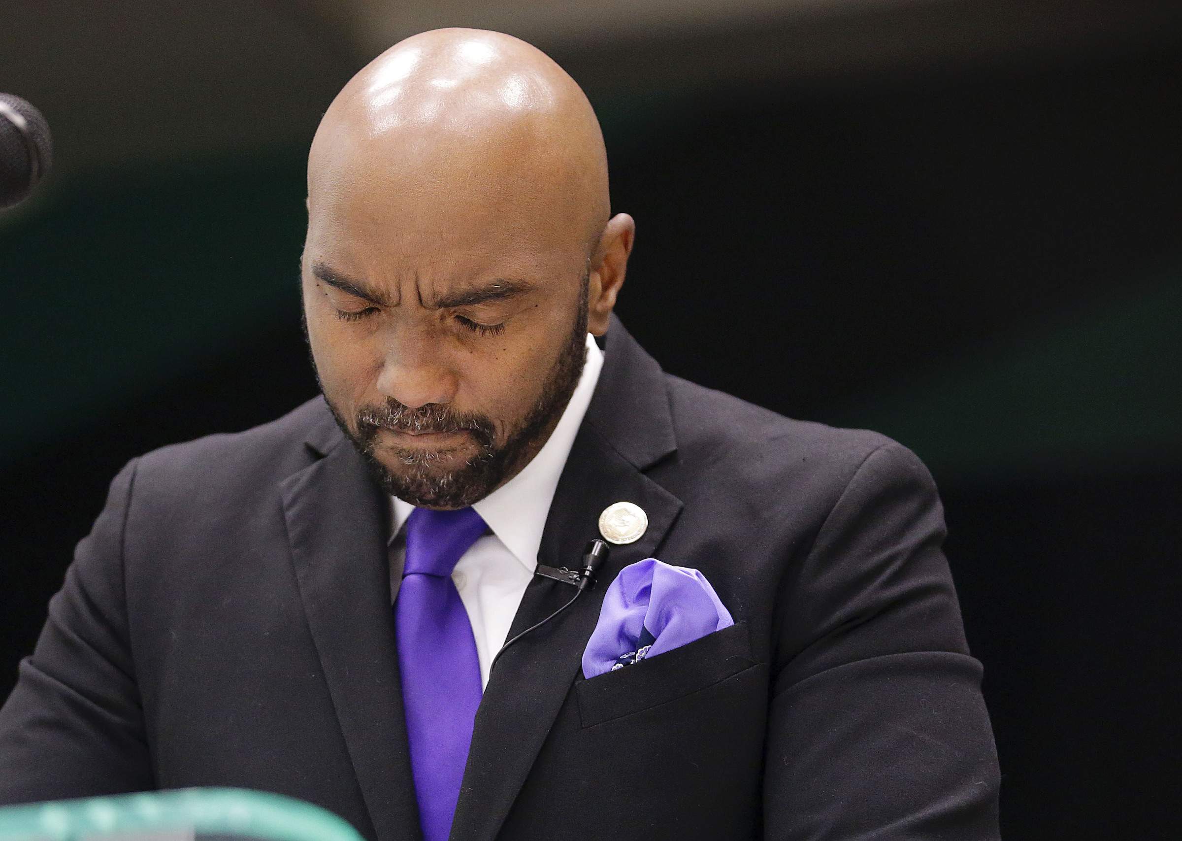 Attorney Damario Solomon-Simmons pauses after becoming emotional during a news conference to discuss a 1921 Tulsa Race Massacre lawsuit, Sept. 1, 2020.