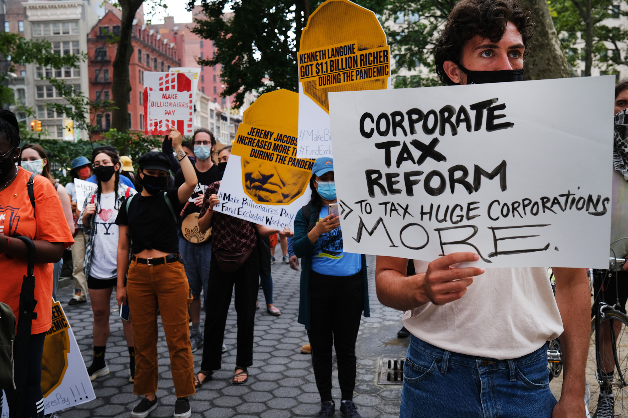 People participate in a  March on Billionaires  event on July 17 in New York City. The march called on Governor Andrew Cuomo to pass a tax on billionaires and to fund workers excluded from unemployment and federal aid programs