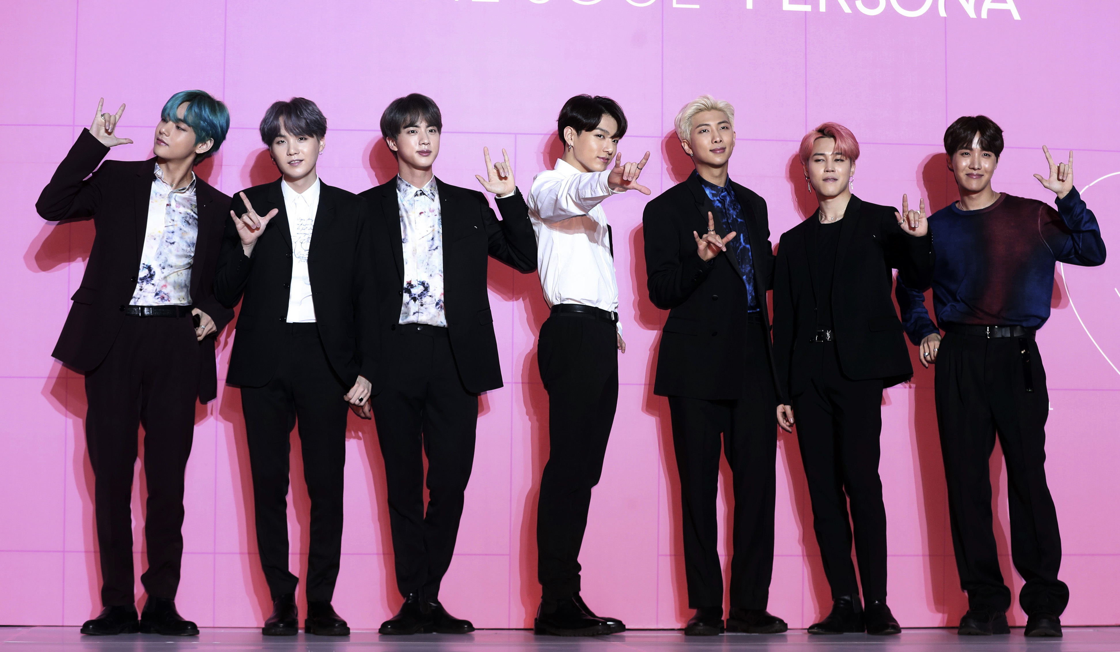 Members of South Korean K-Pop group BTS appear during a press conference in Seoul, South Korea, on April 17, 2019.