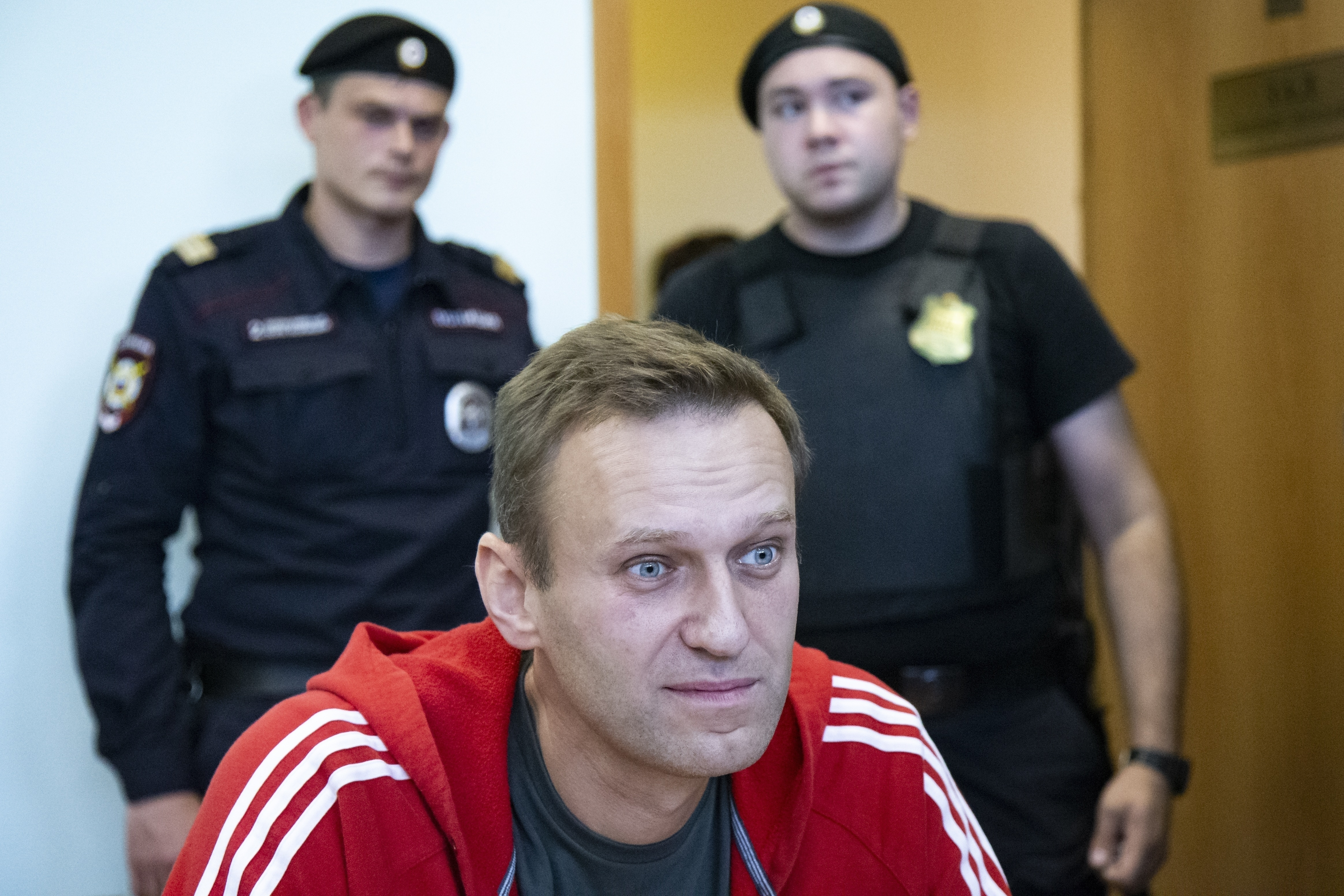 In this file photo taken on Thursday, Aug. 22, 2019, Russian opposition leader Alexei Navalny speaks to the media prior to a court session in Moscow, Russia.