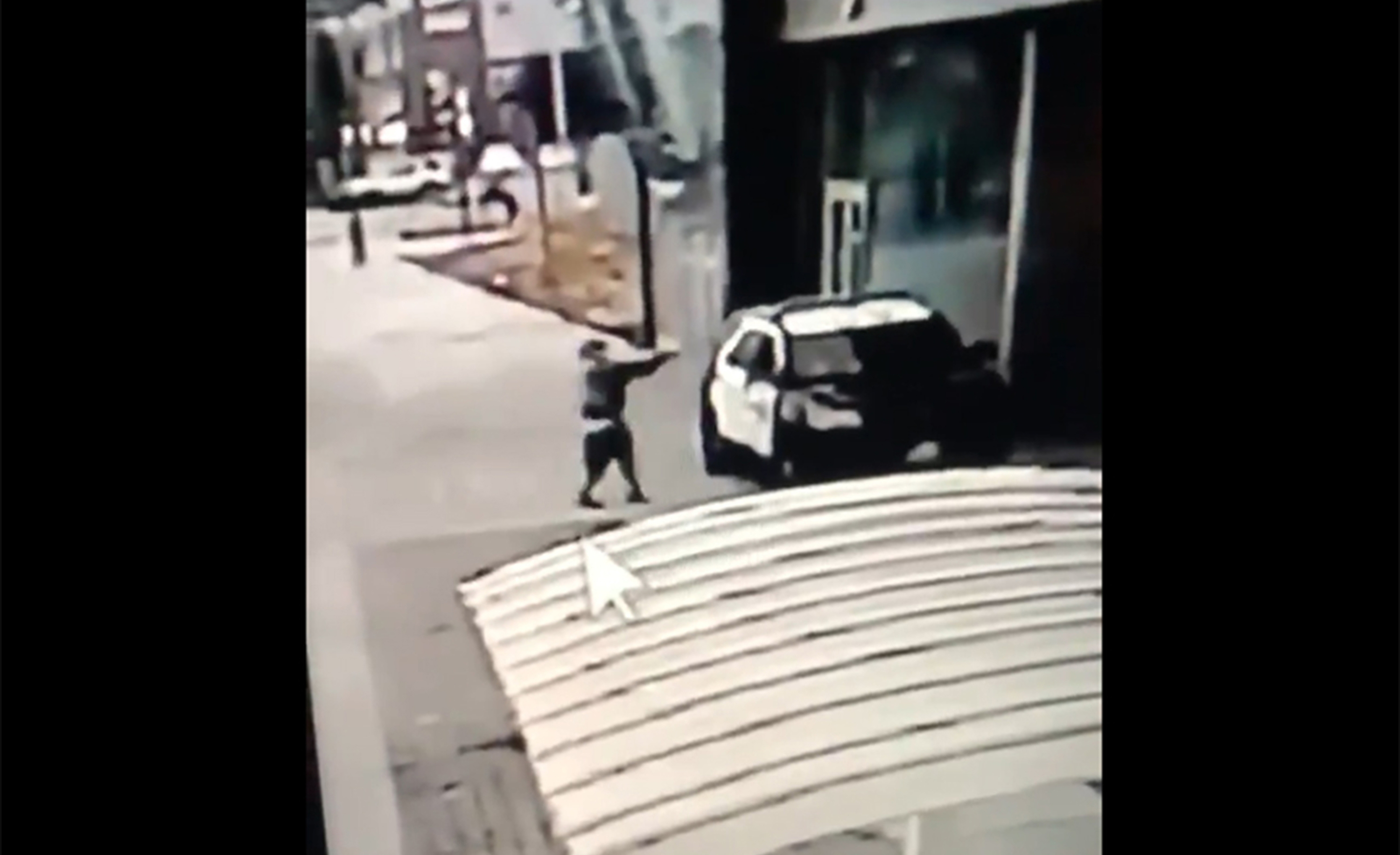 A screen grab from a security camera video released the Los Angeles County Sheriff's Department shows a gunman walking up to sheriff's deputies and opening fire without warning or provocation in Compton, Calif., on Saturday, Sept. 12, 2020.