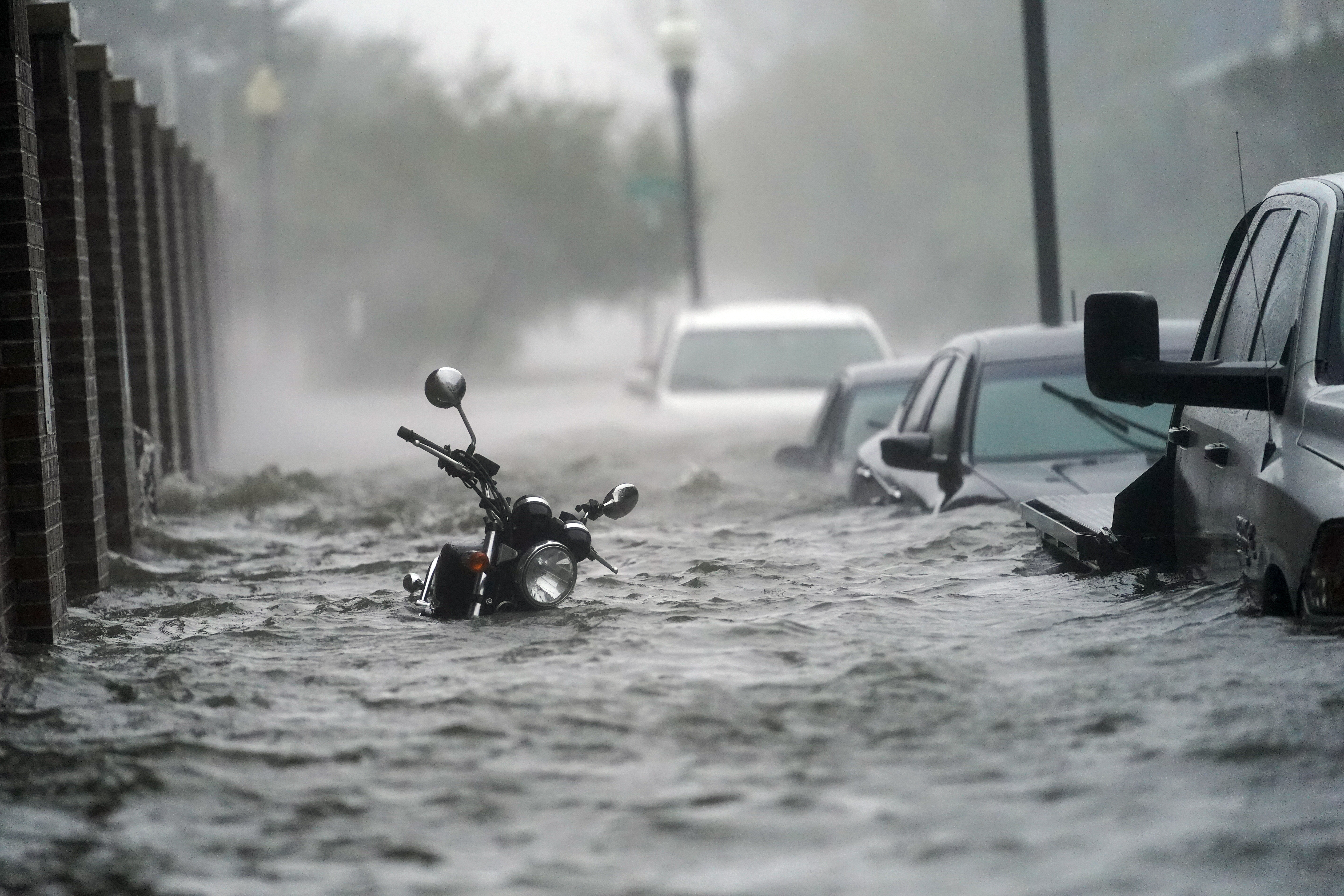 Floodwaters move on the street, Wednesday, Sept. 16, 2020, in Pensacola, Fla.